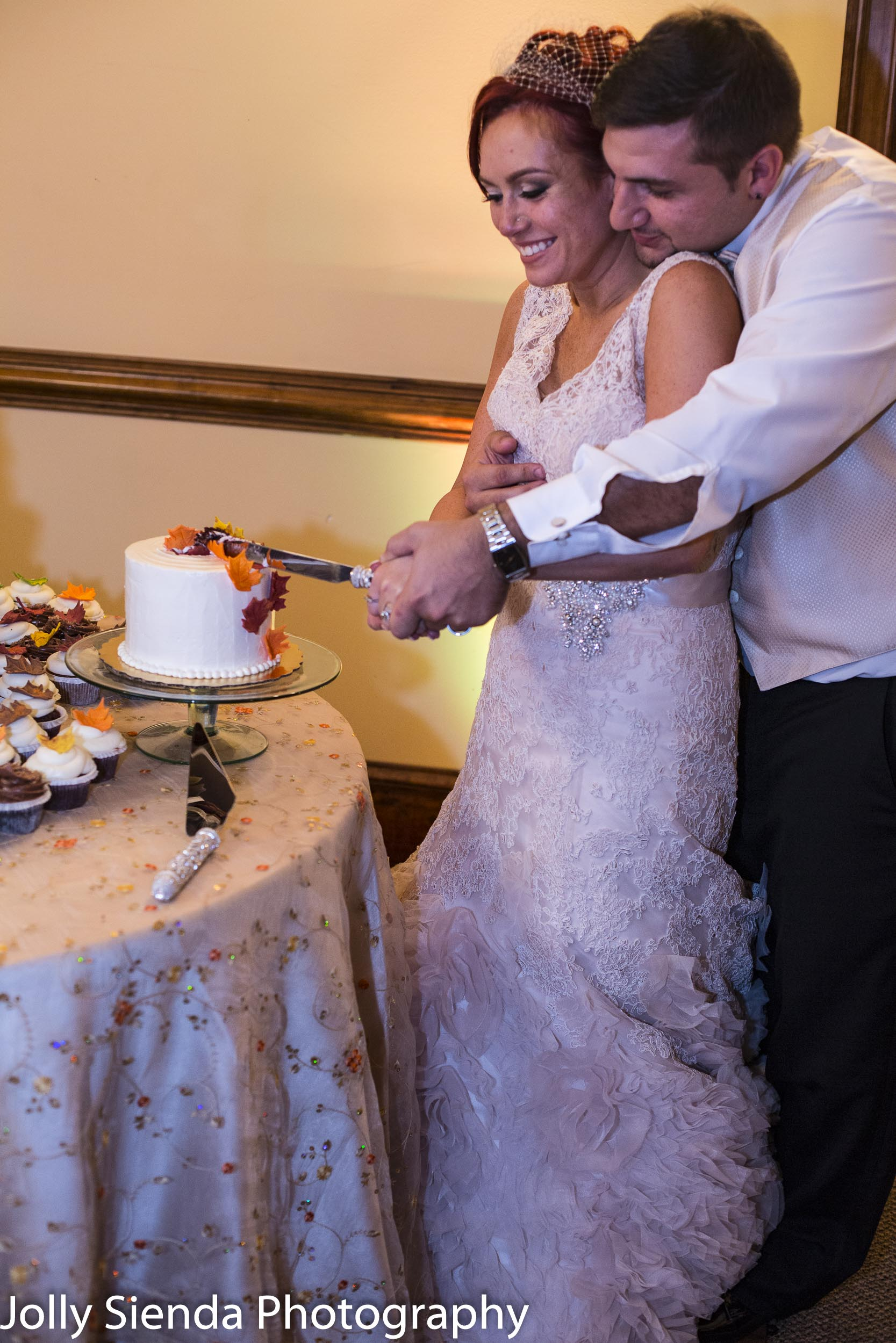 Cutting the autumn wedding cake
