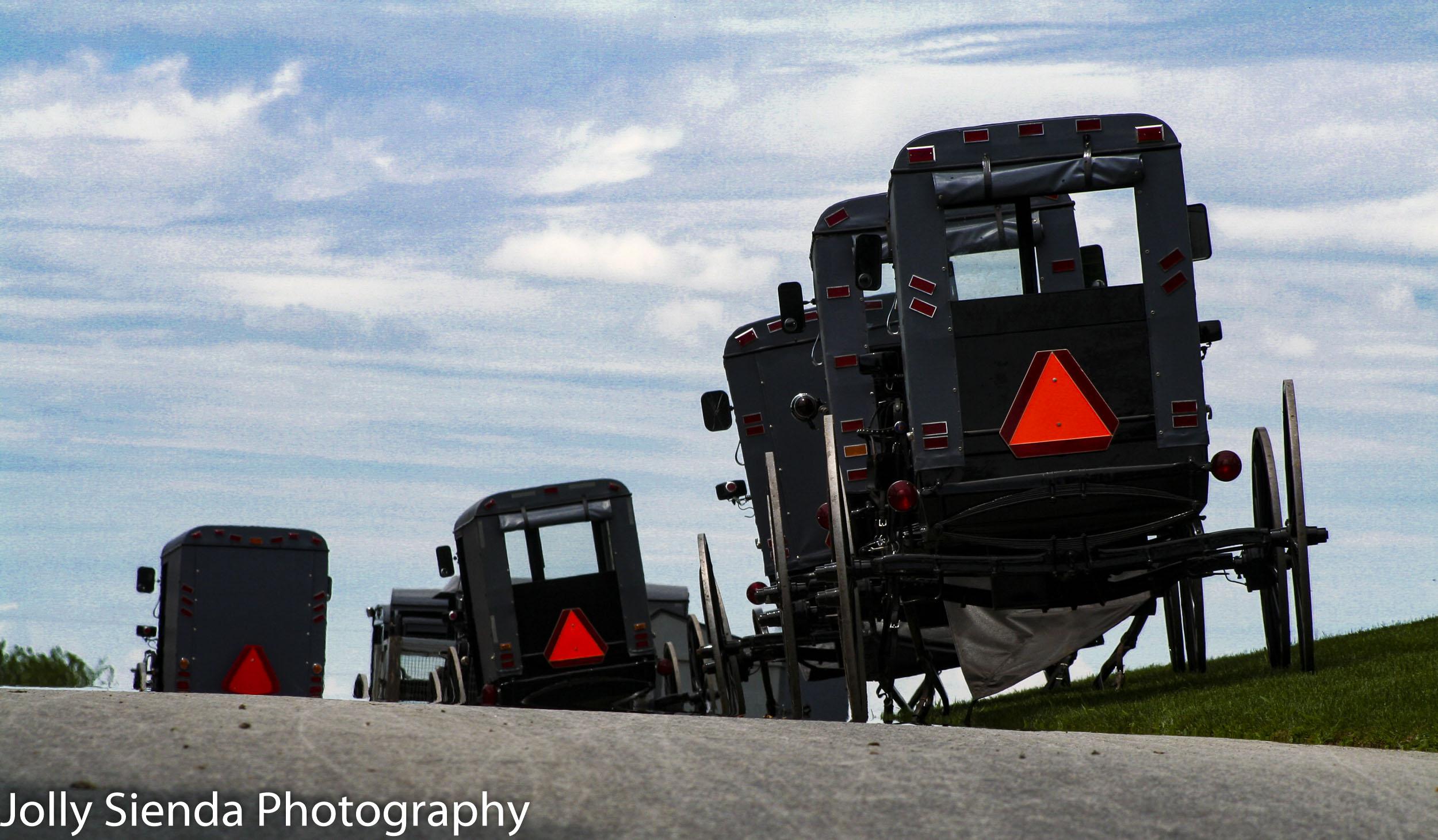 Parked Amish grey buggies