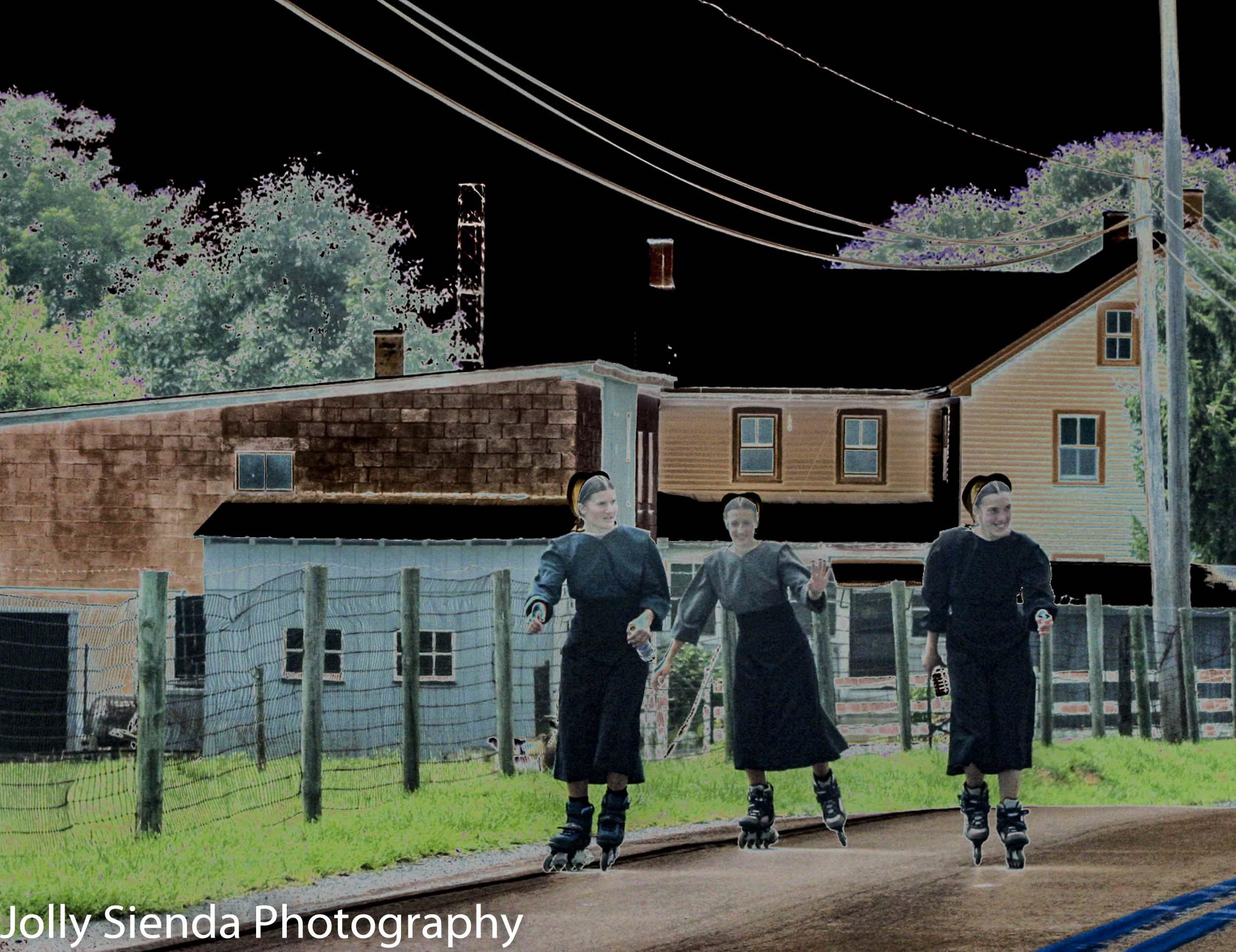 Amish girls rollerblading