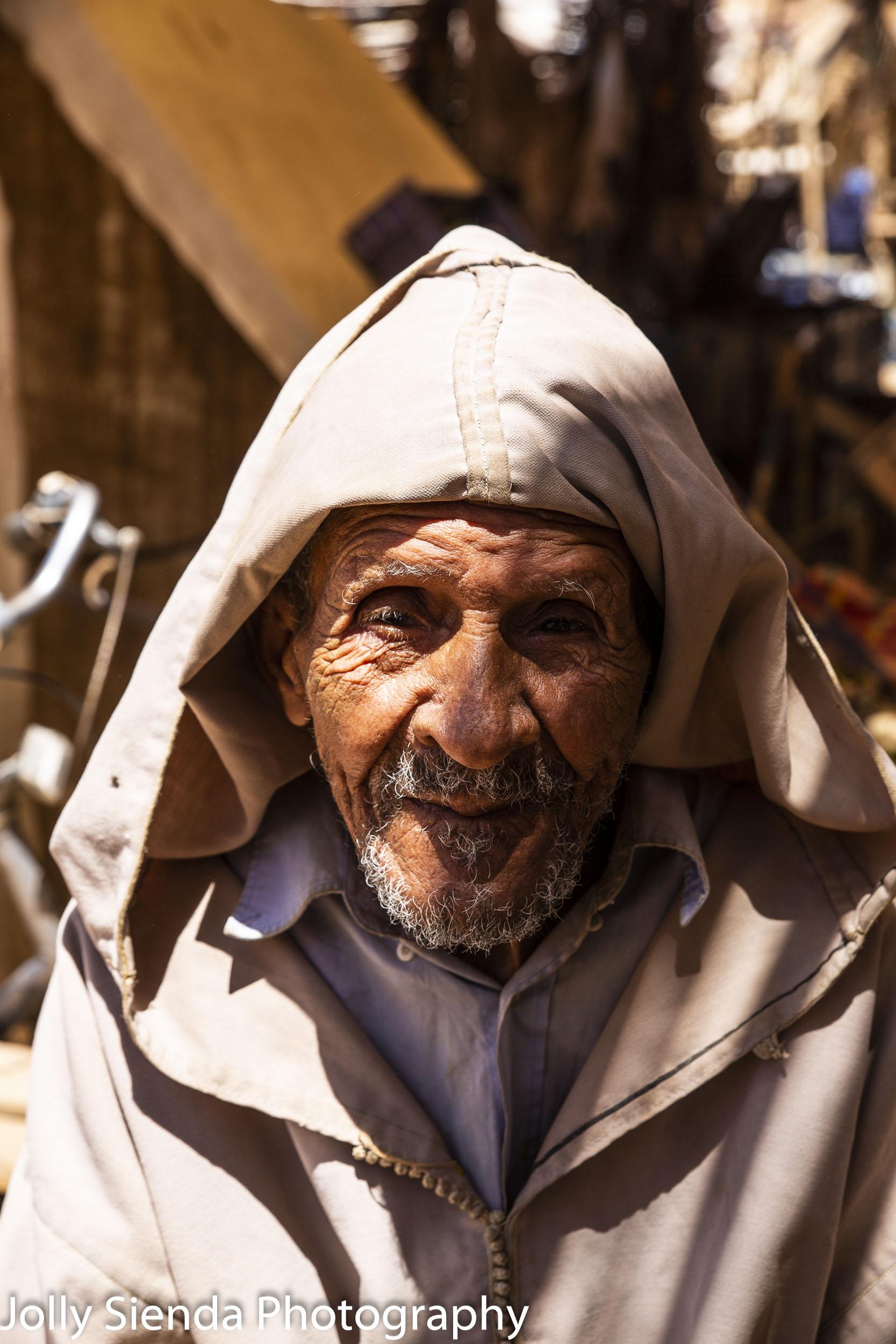 Portrait of an elder man wearing a jabala