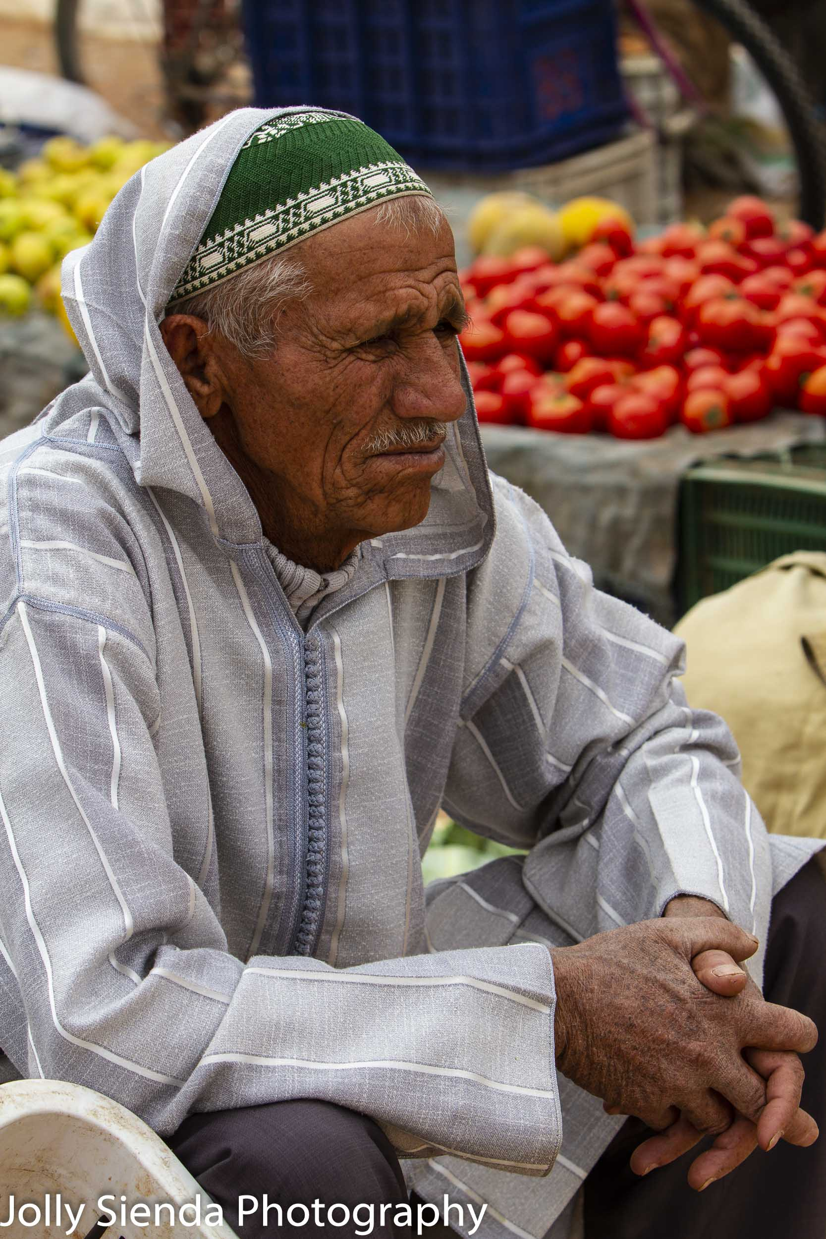 Man ponders at the outdoor market
