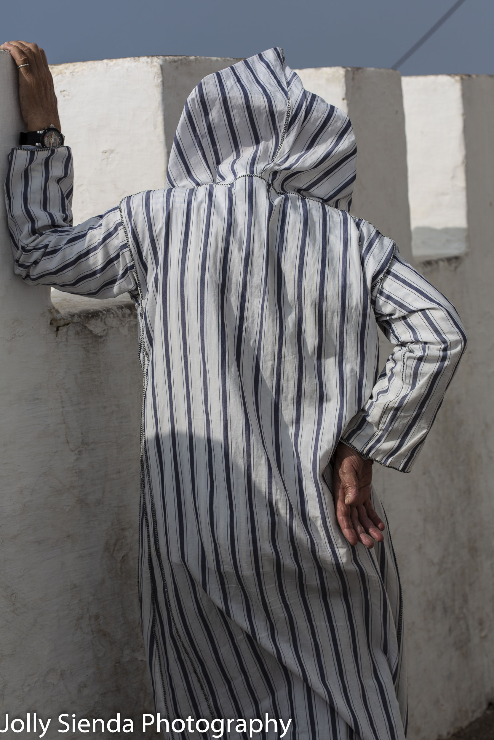 Back of a man wearing a pinstriped Jabala