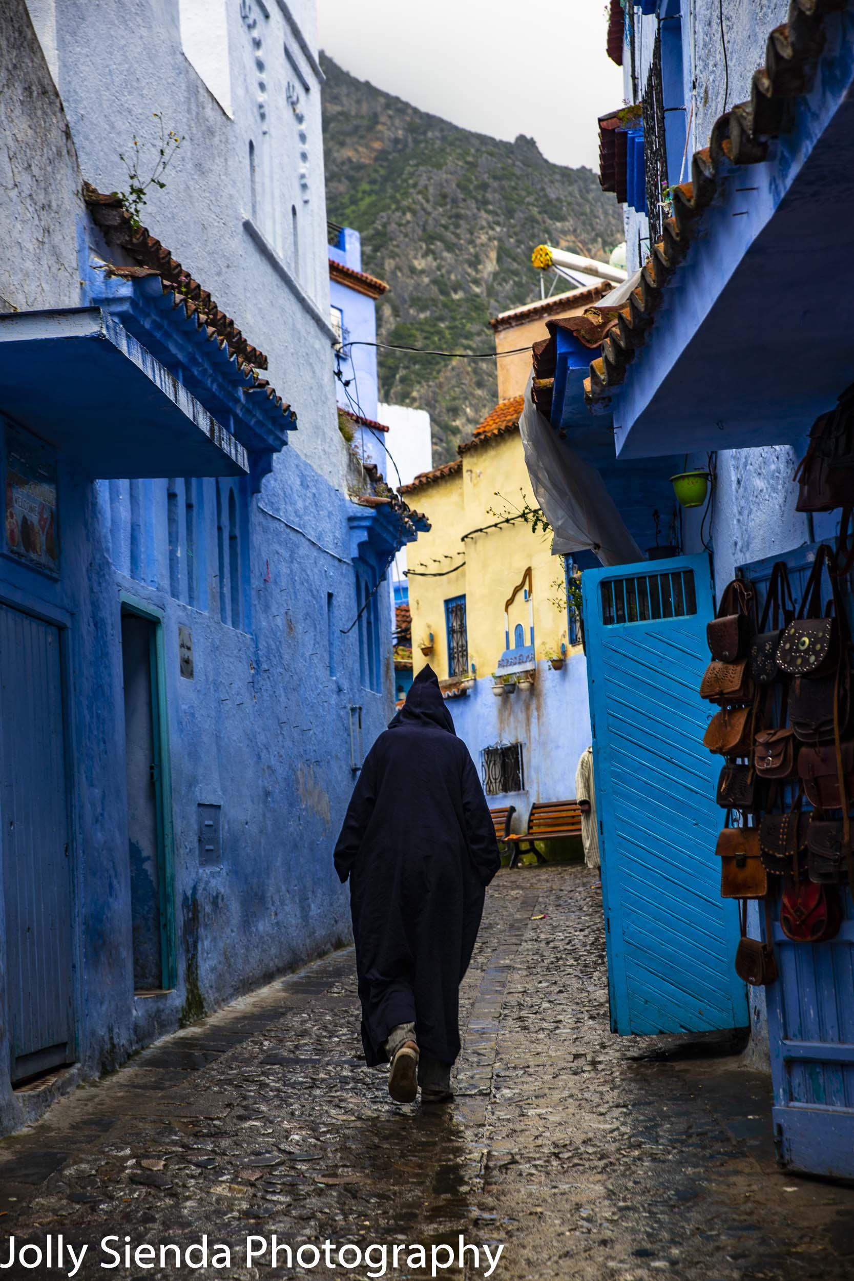 Moroccan man wears djellaba in blue Chefchaouen