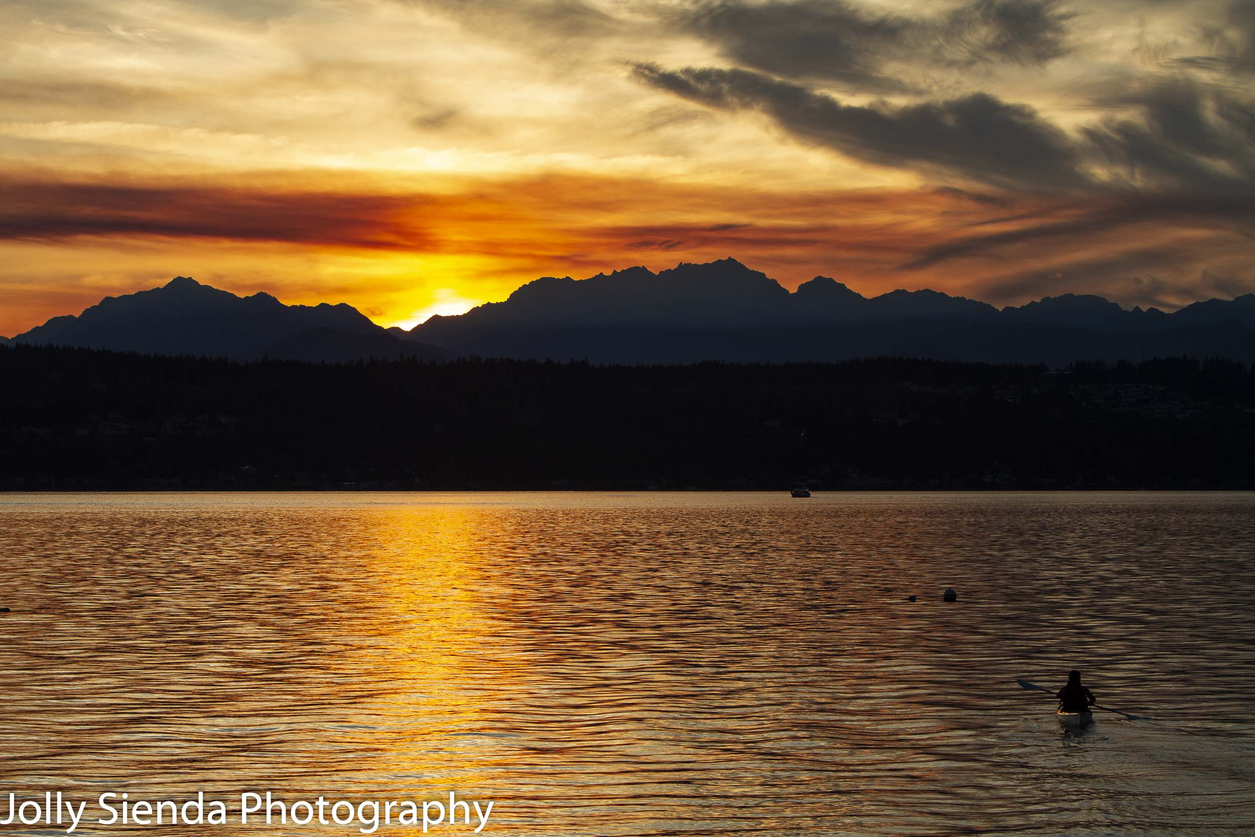 Kayaking at sunset towards the Olympic Mountains on the Puget So