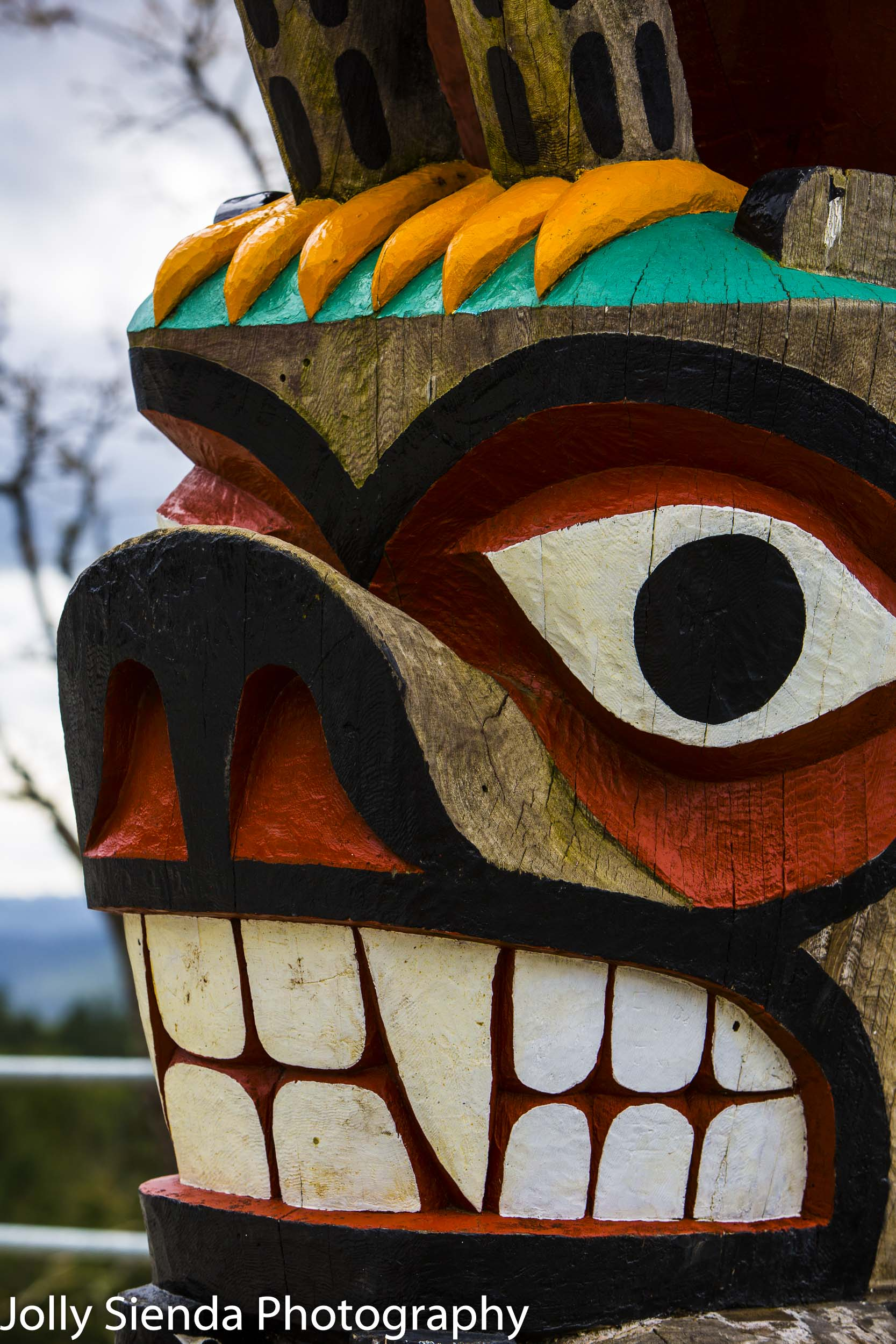 Salish bear smiles with teeth totem pole, First Nation