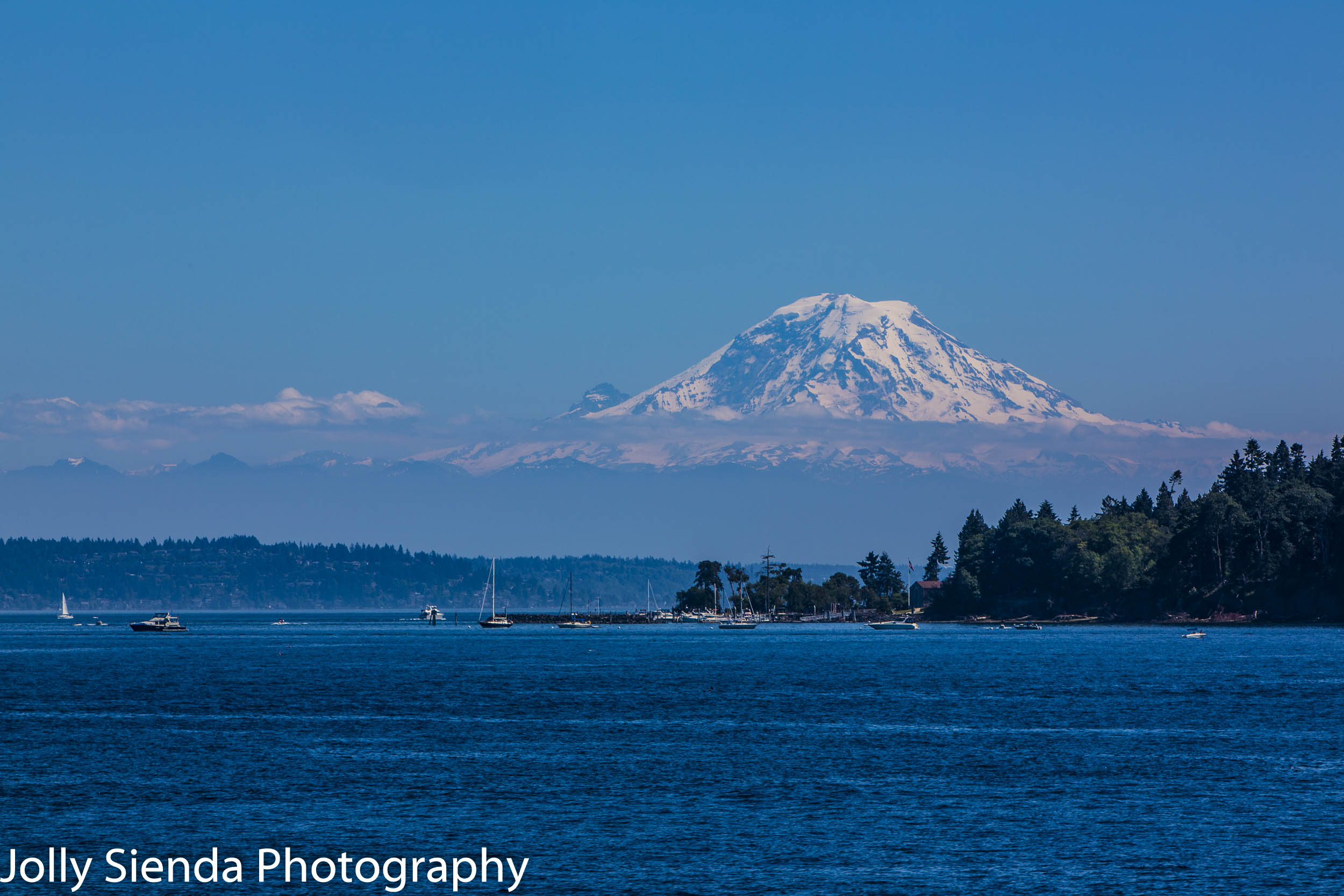 Mount Rainier with a cloud band towers over the Puget Sound and