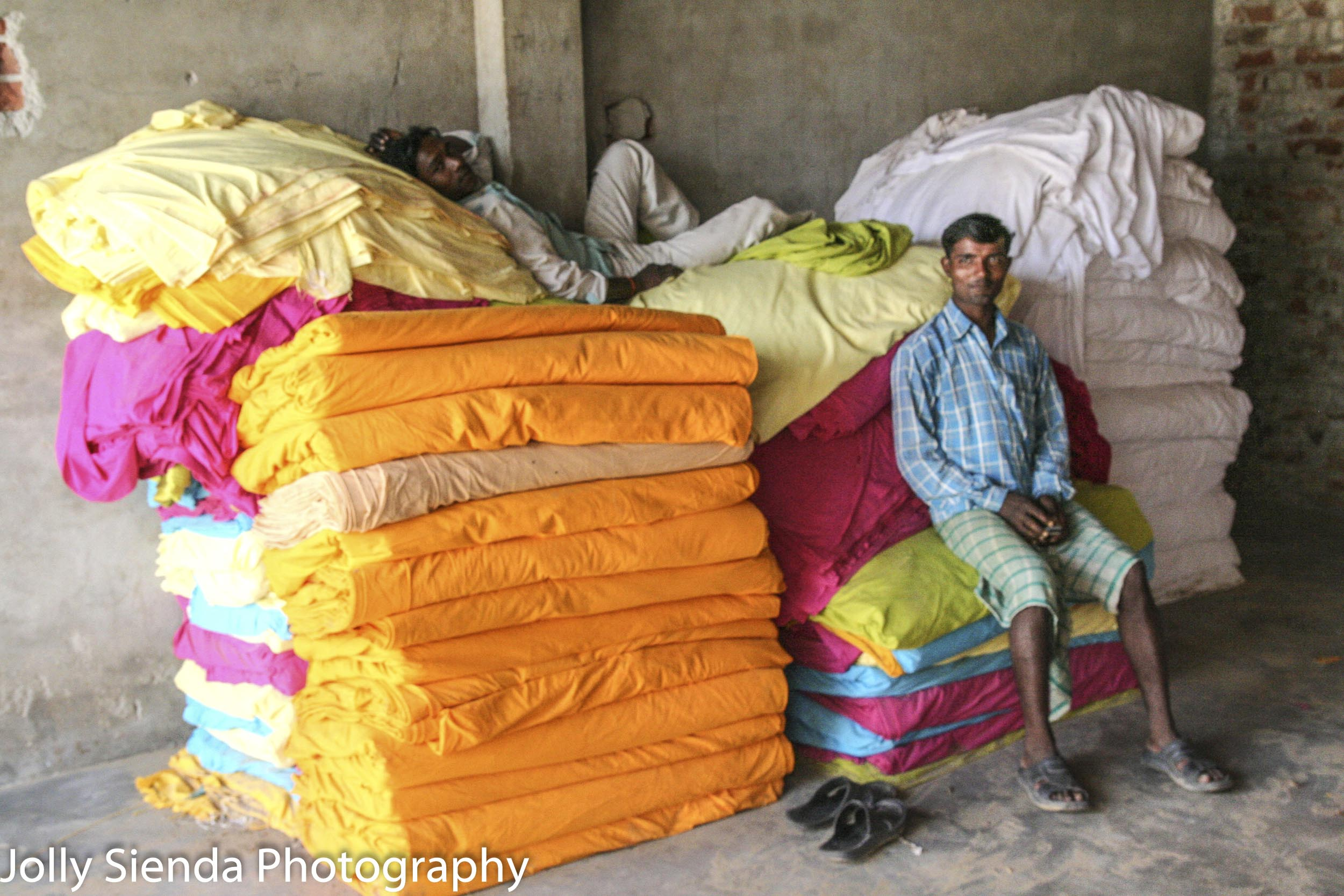 Print block factory workers rest on material