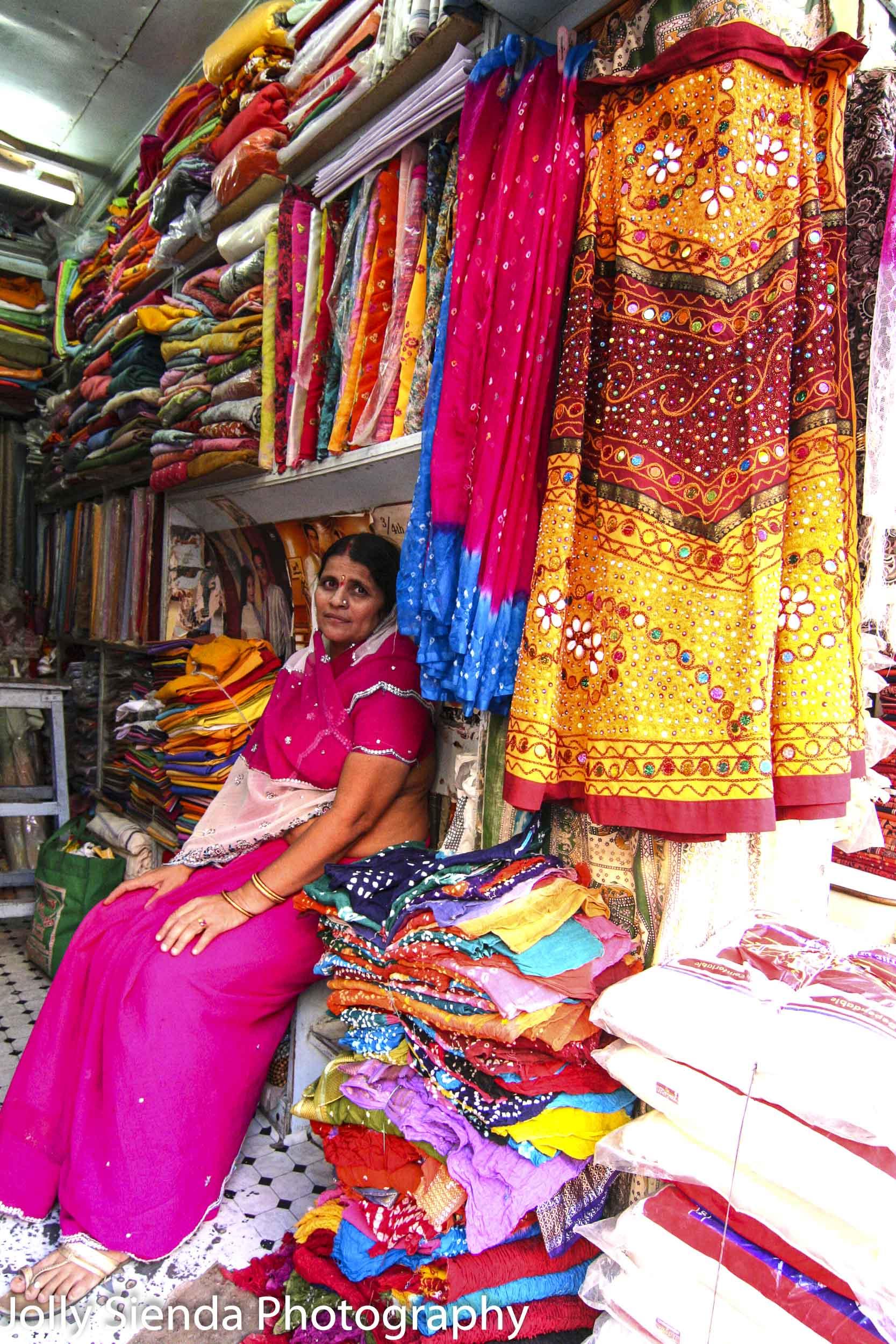 Woman selling saris