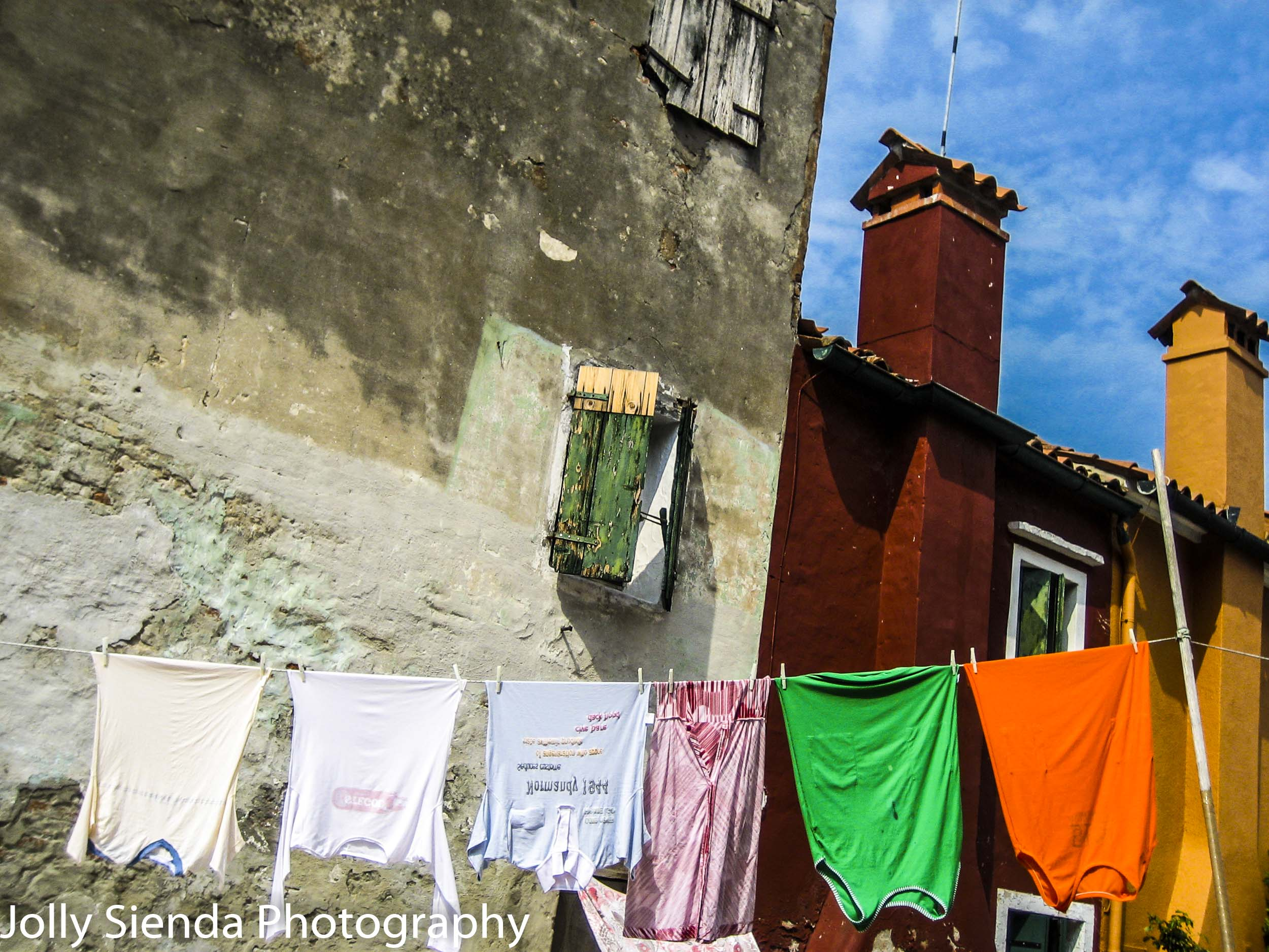 Laundry Hangs on a Clothes Line between Painted Buildings