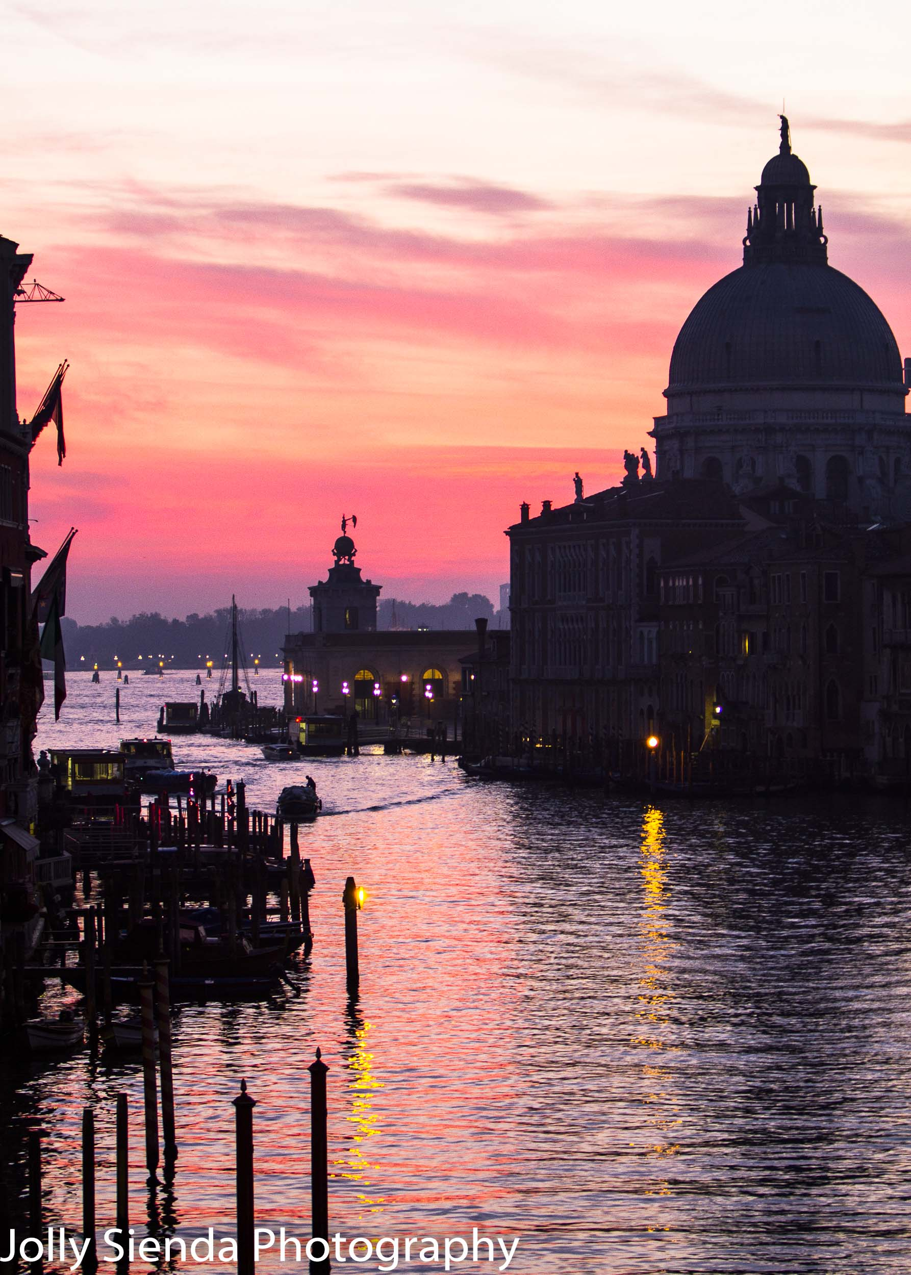Pink and yellow sunrise over Santa Maria della salute and the Gr