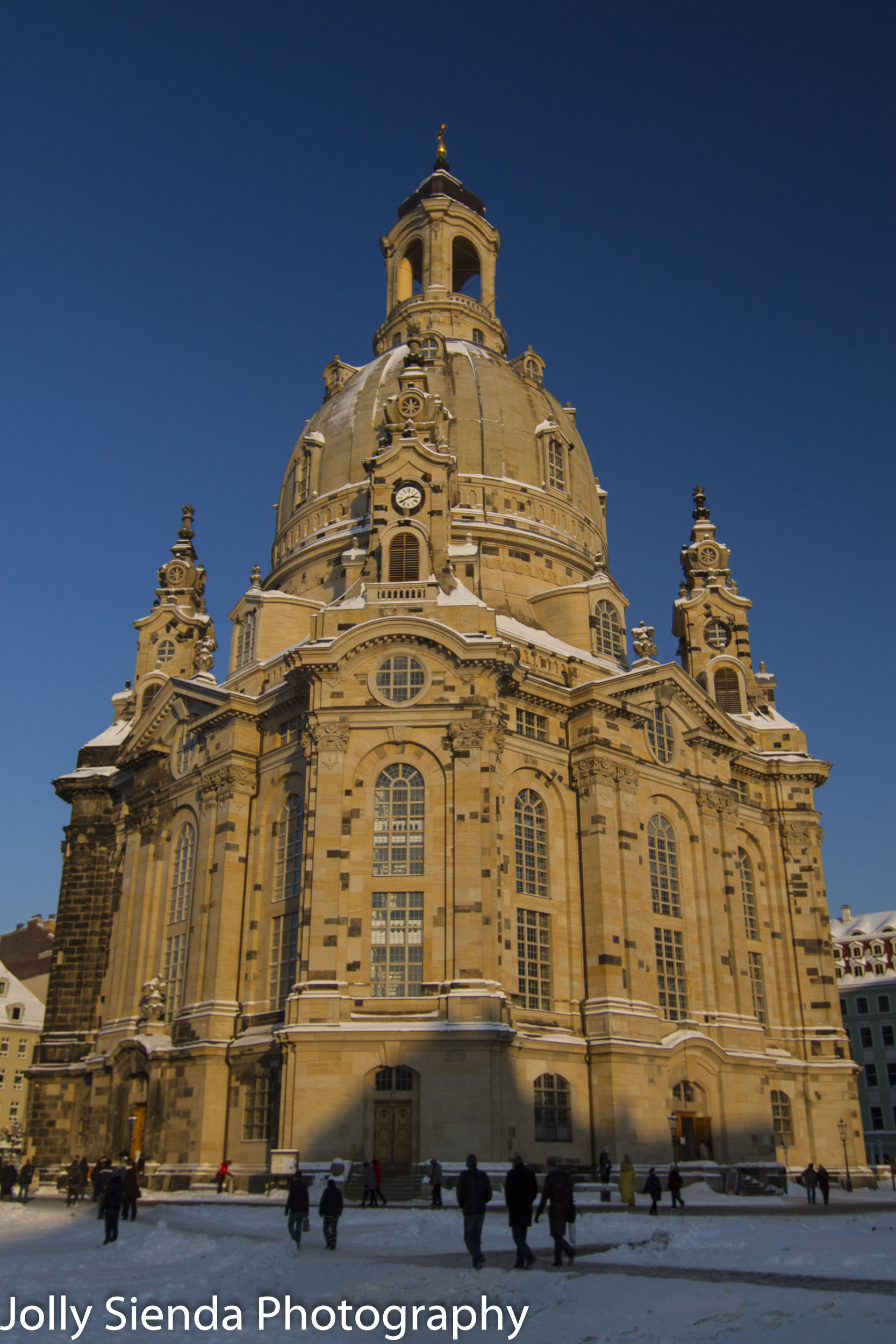 Church of our Lady, Frauenkirche, and people in the snow