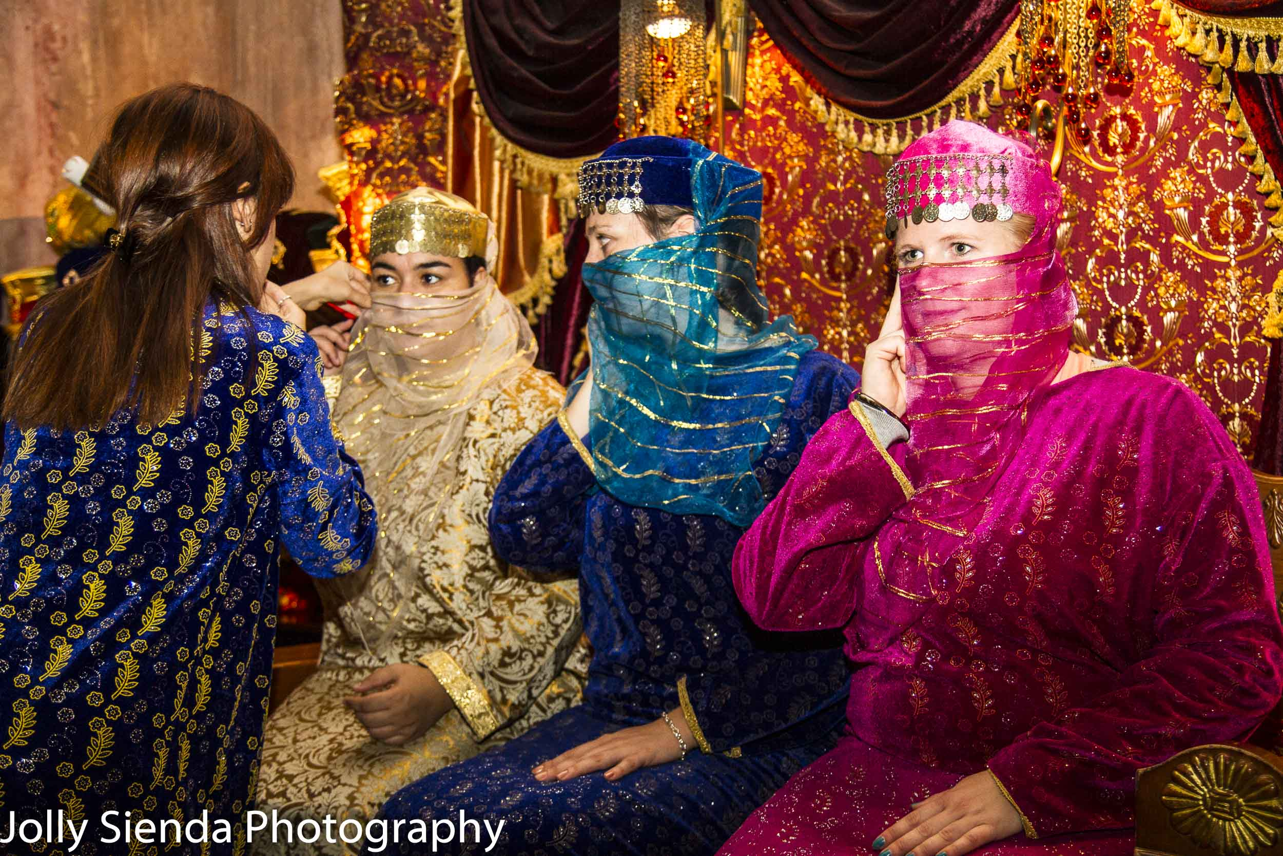 Women wearing colorful abayas