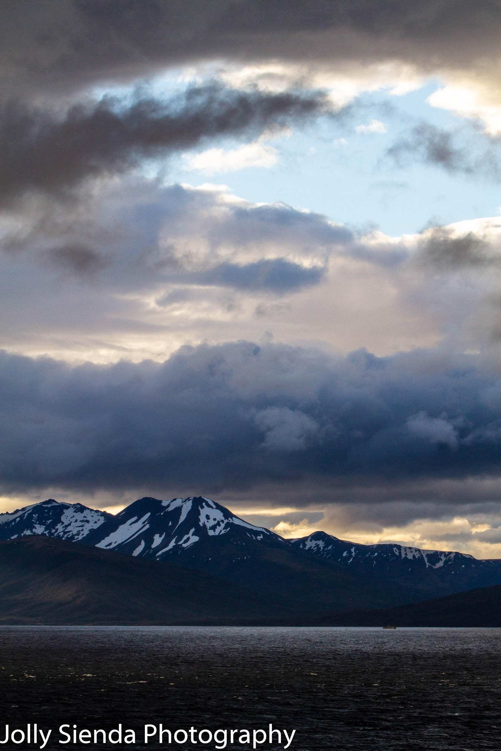 Pastel storm clouds and mountains on the Strait of Magellan