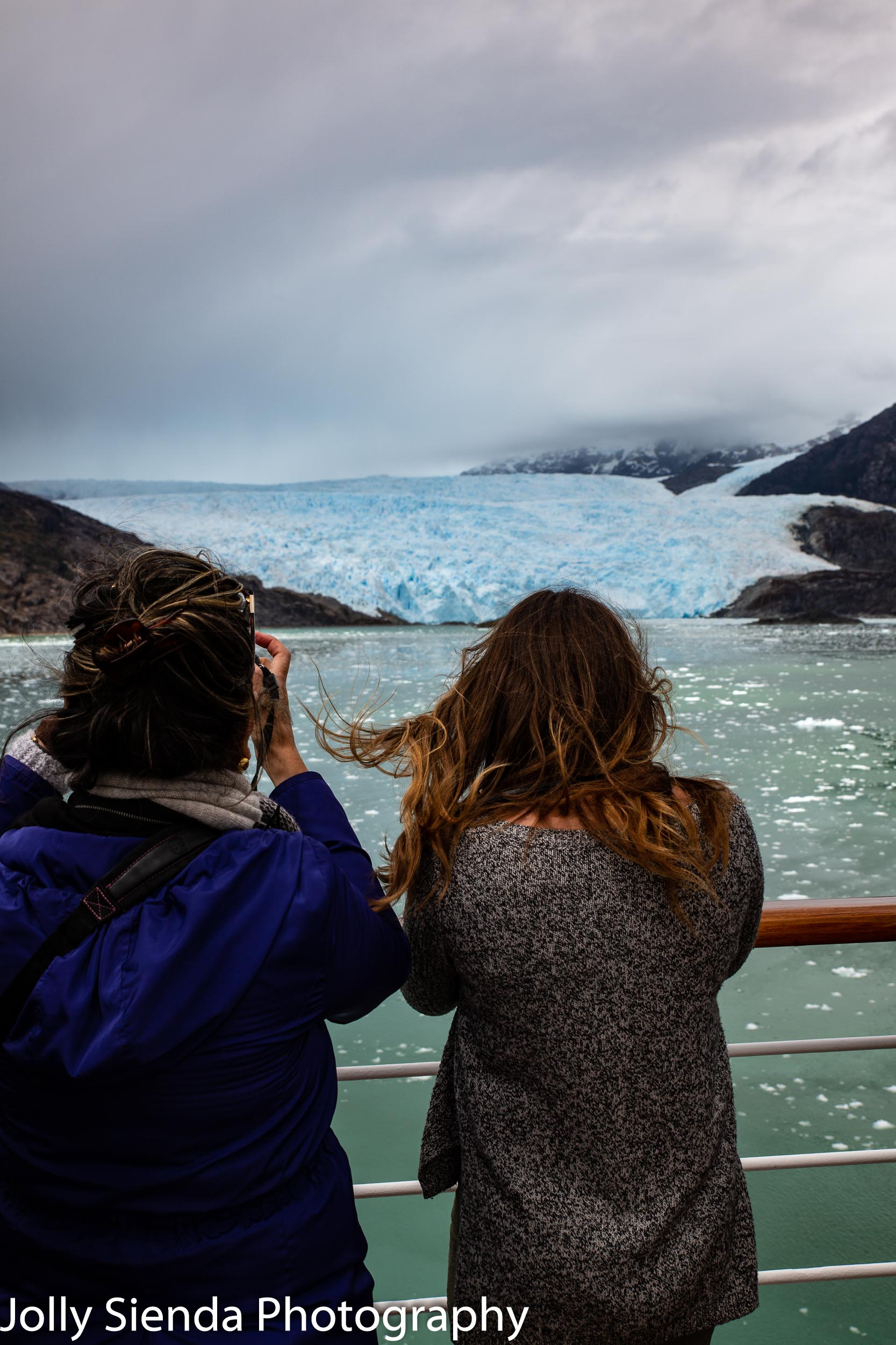 Tourists take pictures of the Brujo Glacier