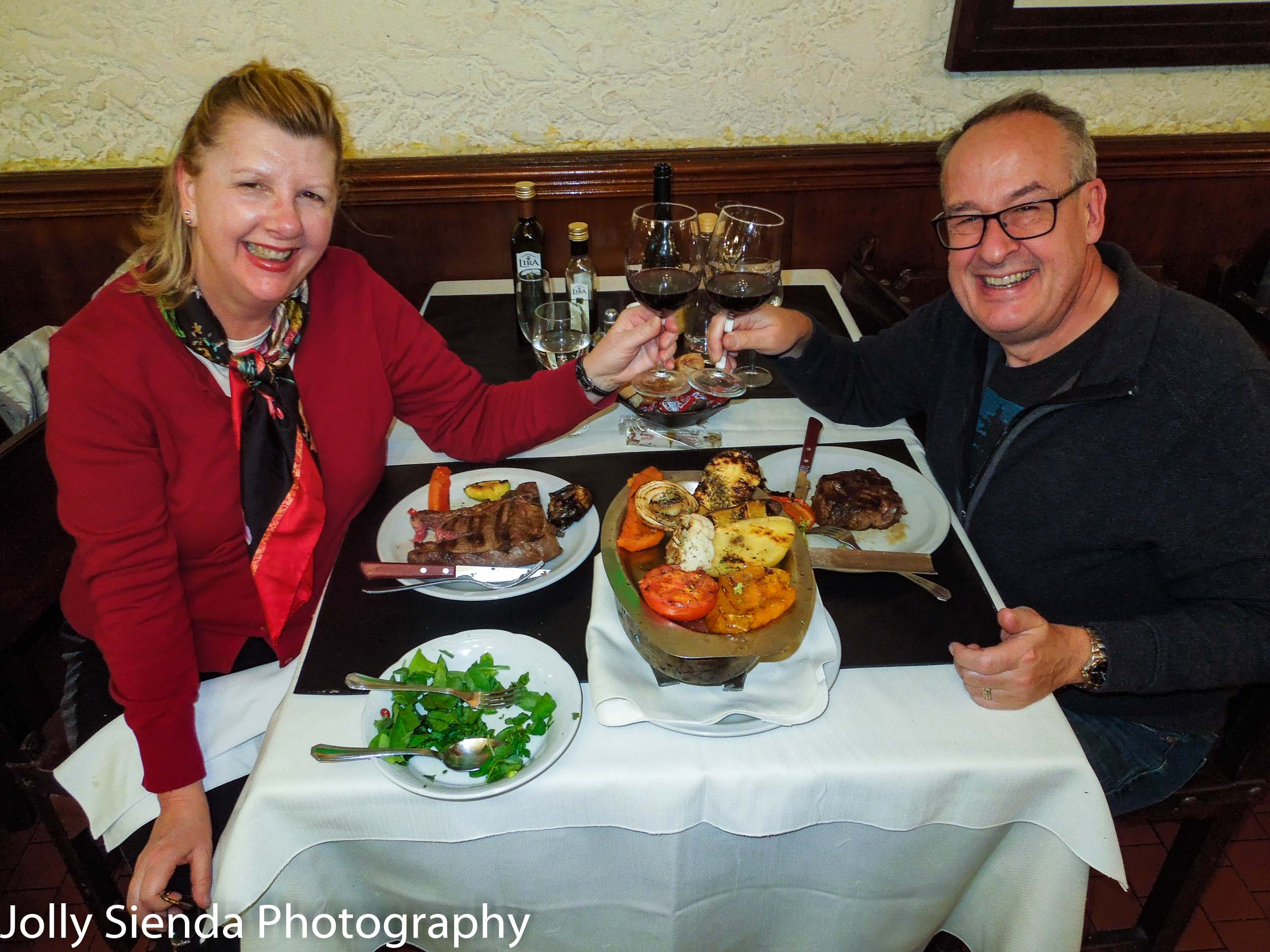 Jolly and Rich eat a steak dinner