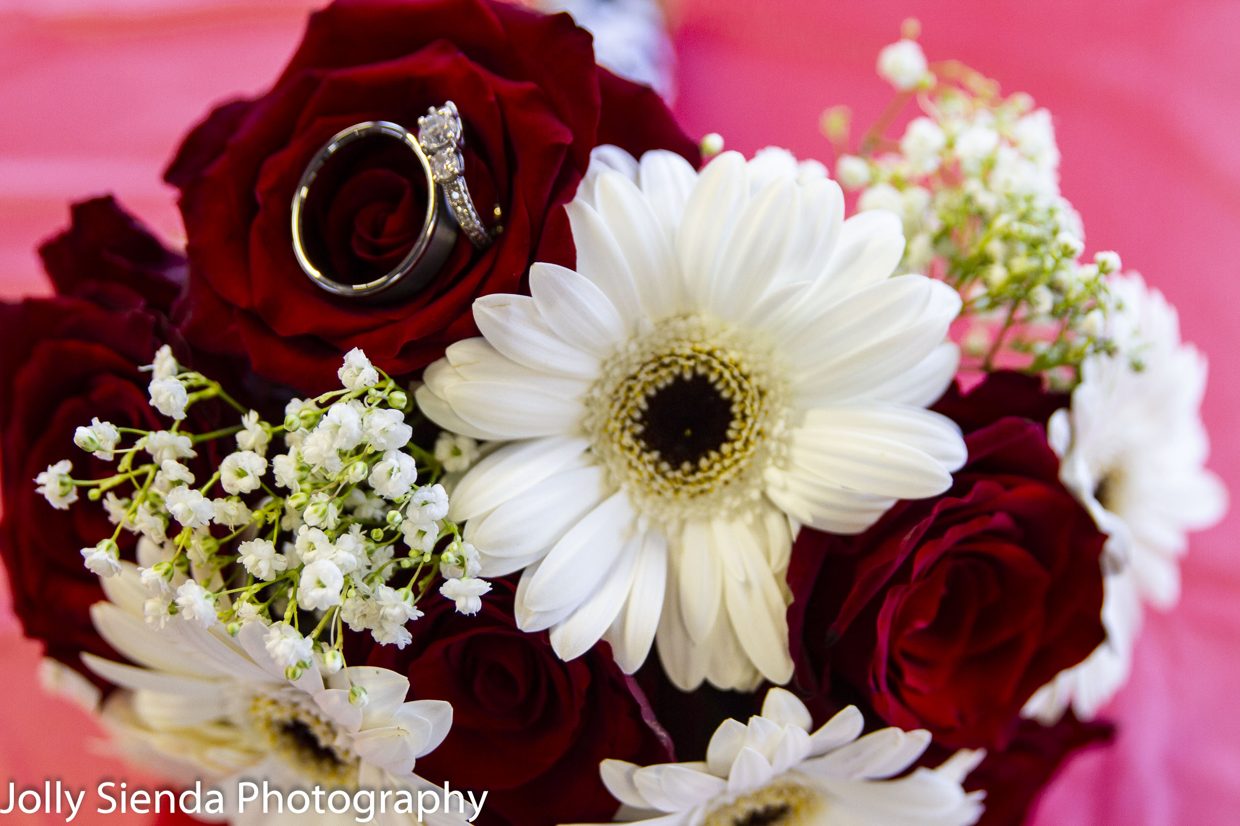 Bride and groom wedding rings in the brides bouquet