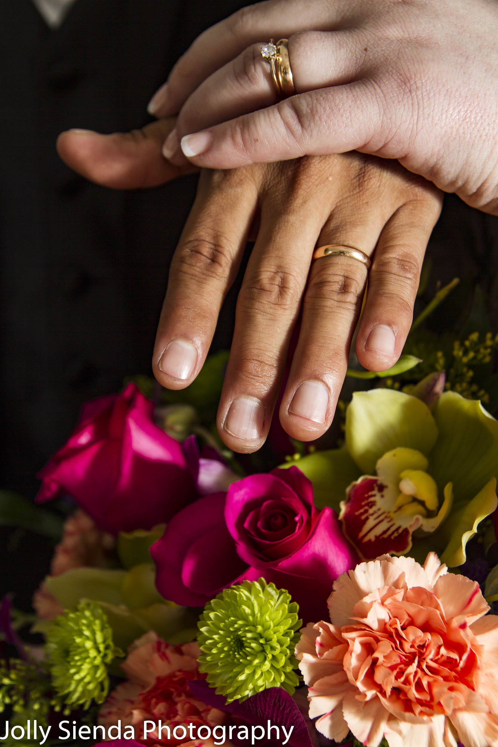 Portrait of the wedding rings and the bouquet