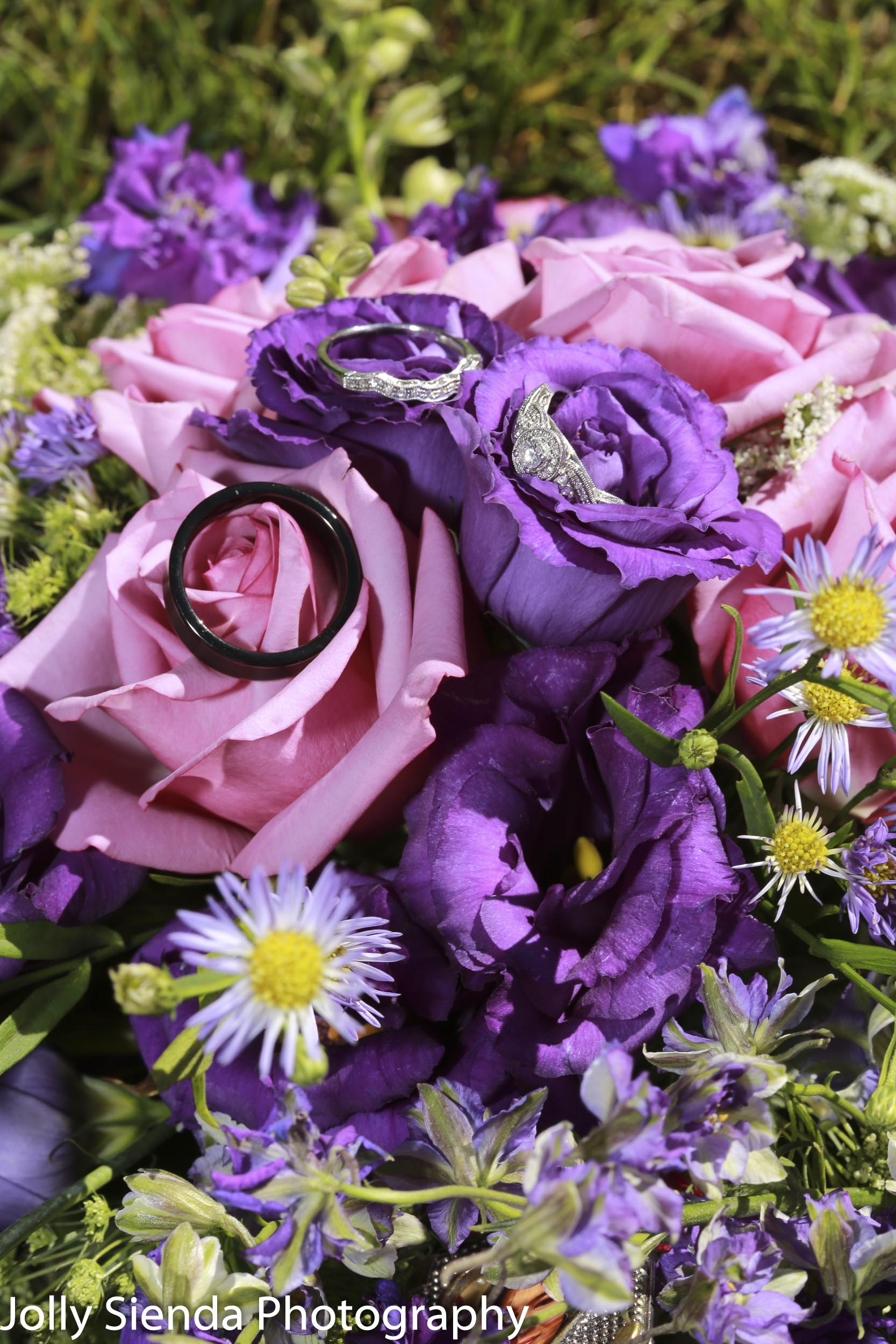 Wedding rings and bridal bouquet wedding photography