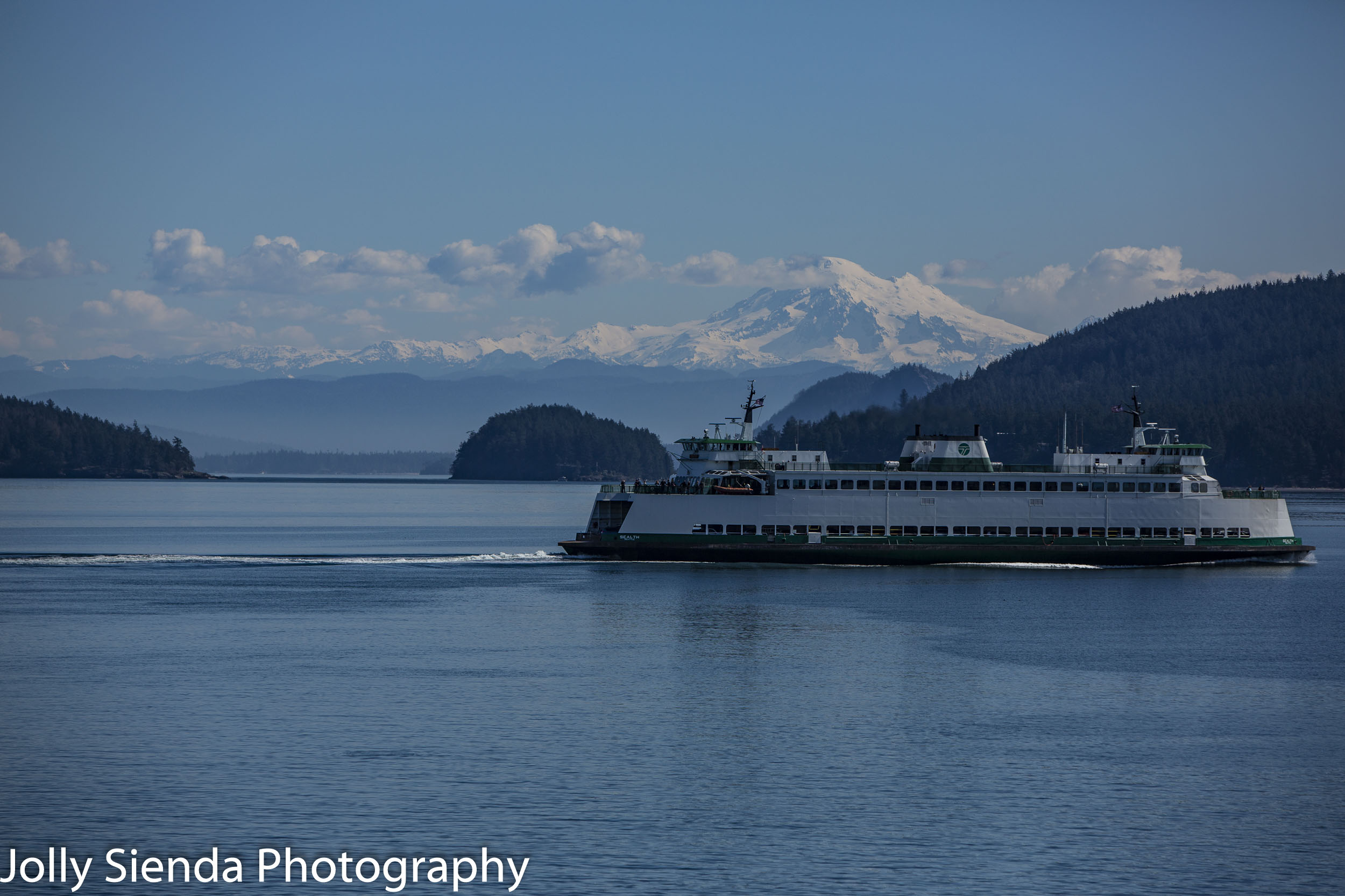 Washington State Ferry sailings in the San Juan Islands with Mount Baker in the background.