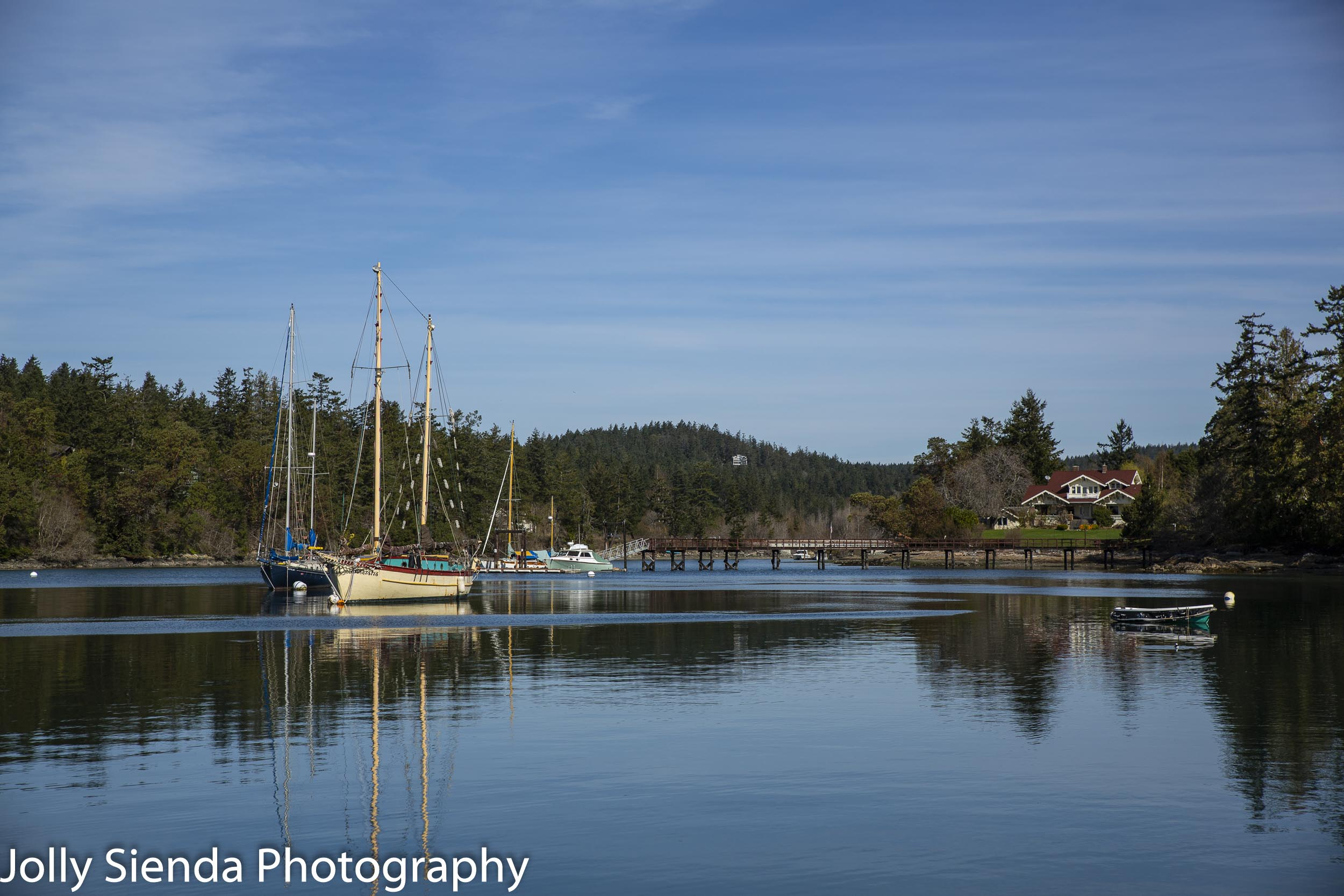 Calm on the water inlet with boats and sailboats