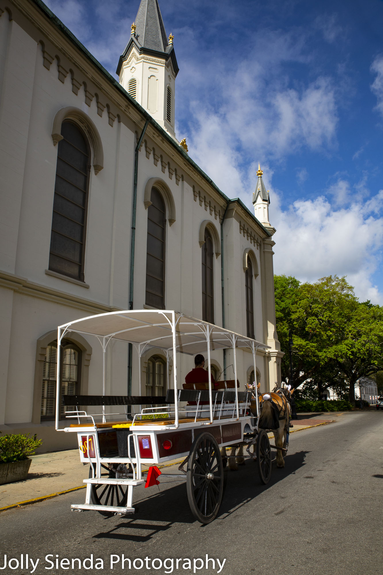 Horse drawn carriage and antebellum church
