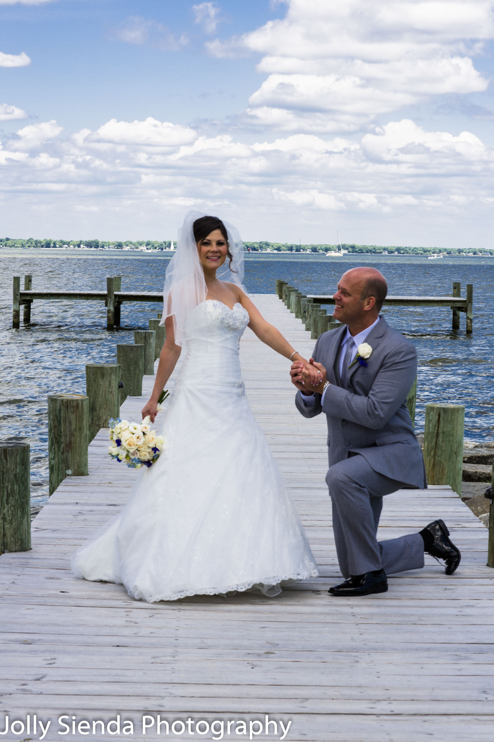 Groom Proposing to the Bride on the Waterfront