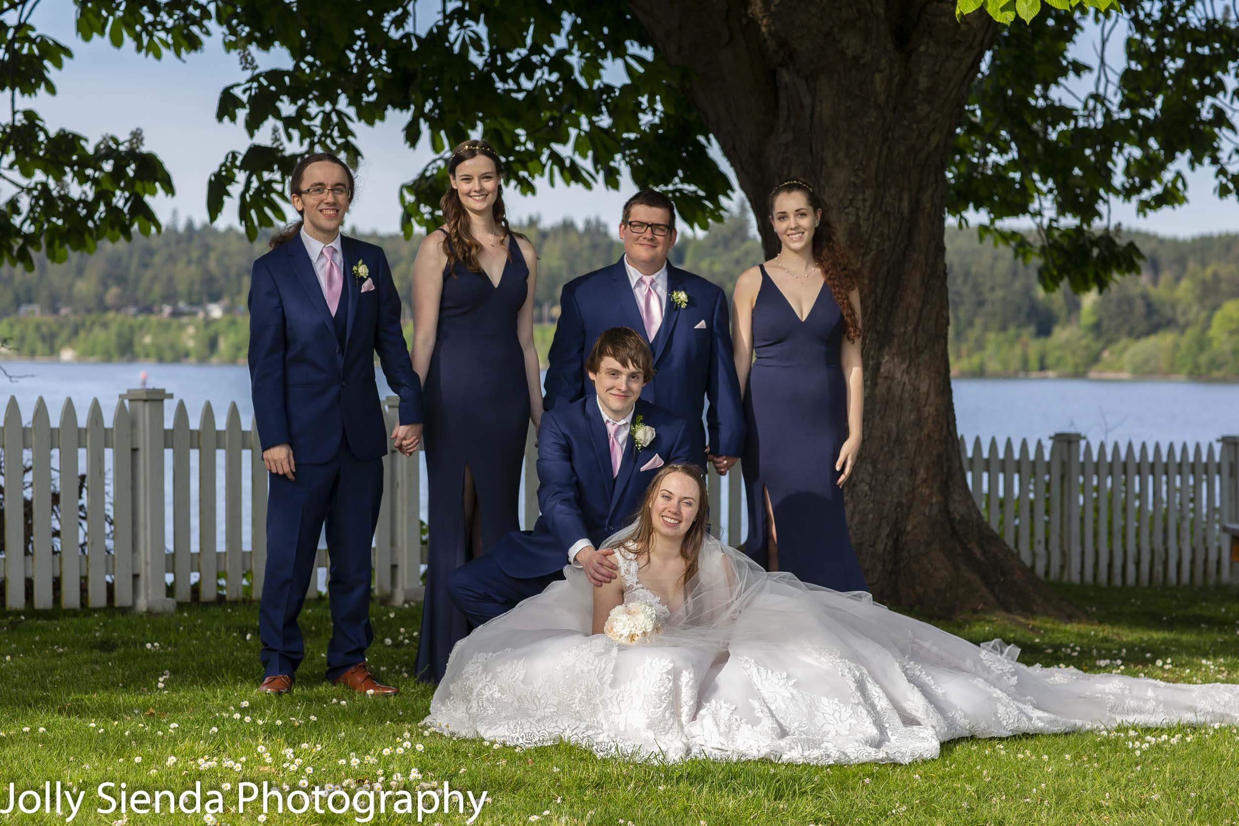 Lily, Aaron, and their wedding party at Port Gamble.