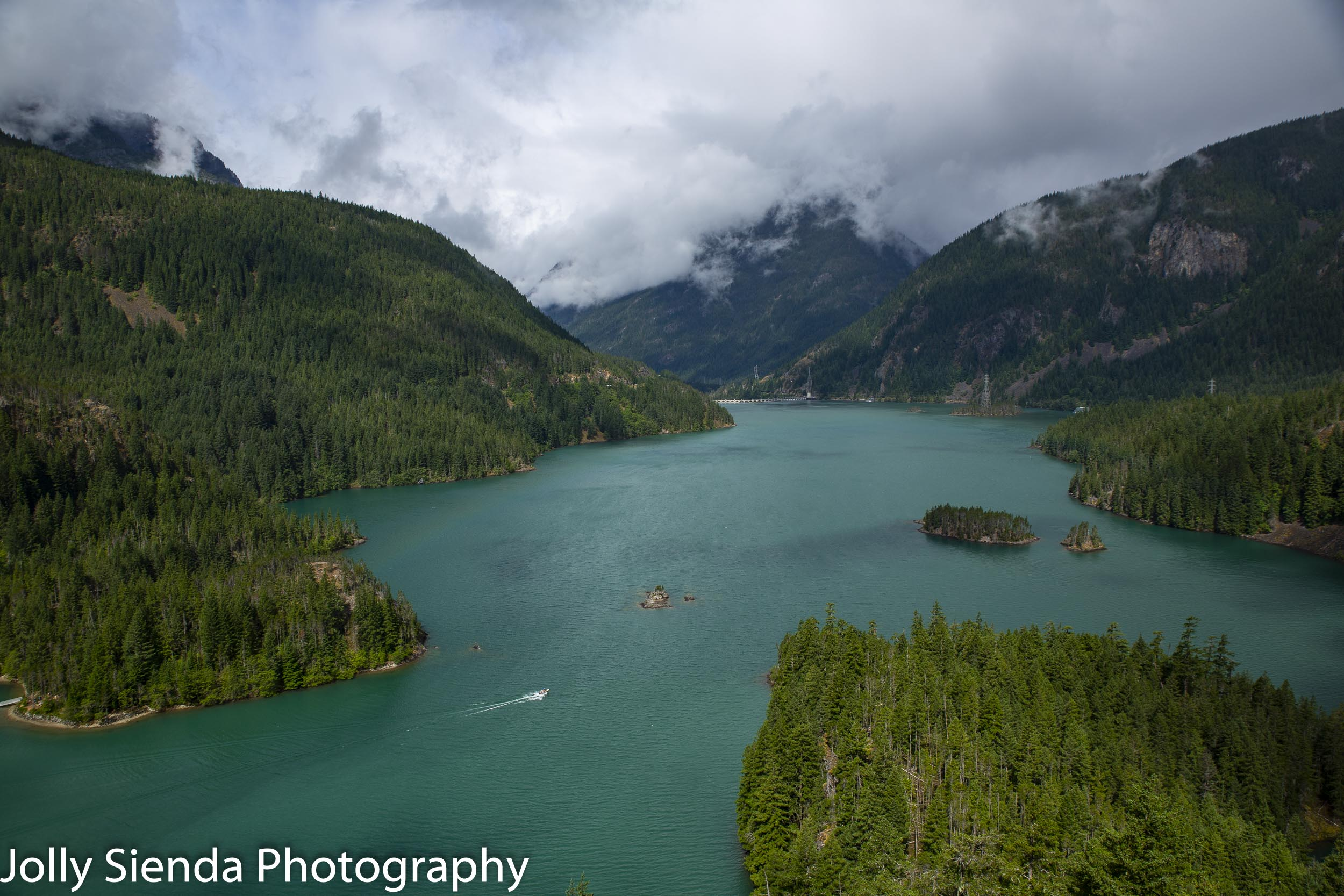 Diablo Lake where you can boat on the lake to the Diablo Dam surrounded by the North Cascades