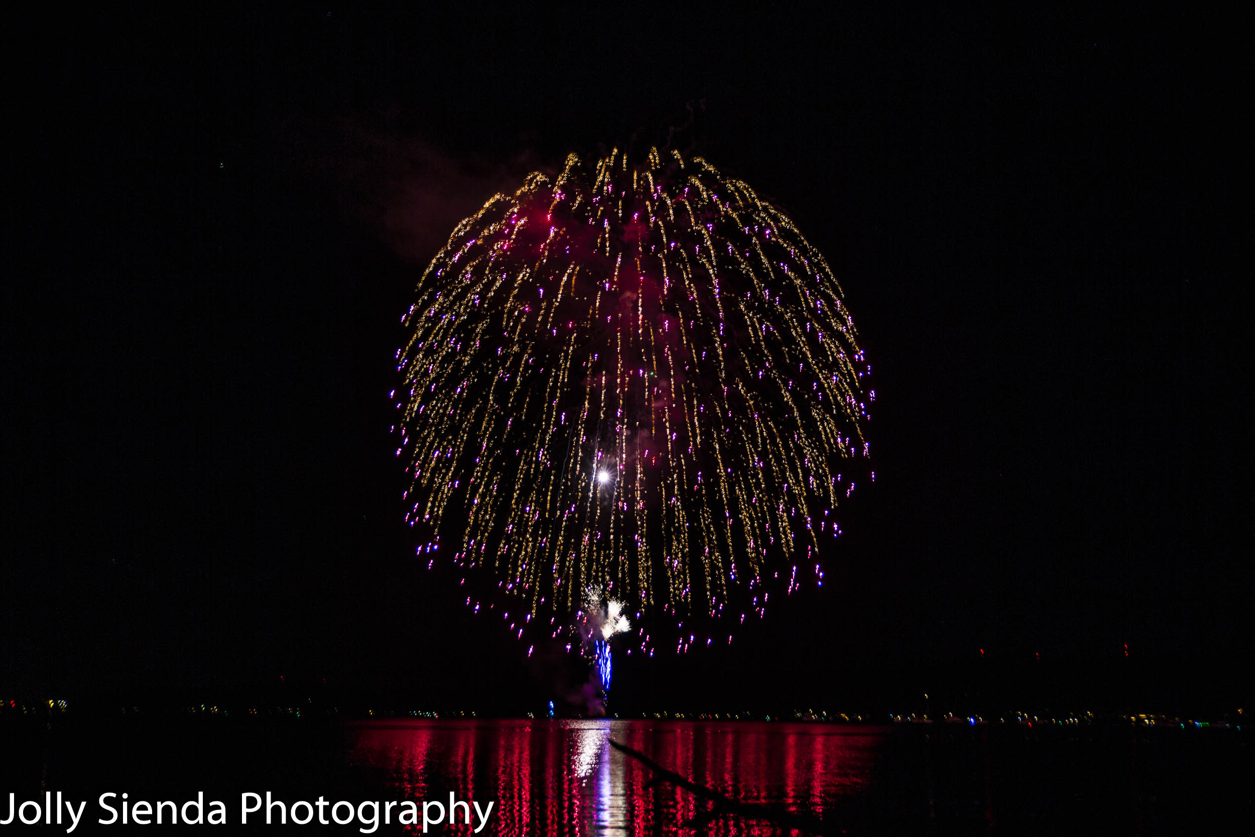 Long fireworks burst over Dyes Inlet, Silverdale, WA.