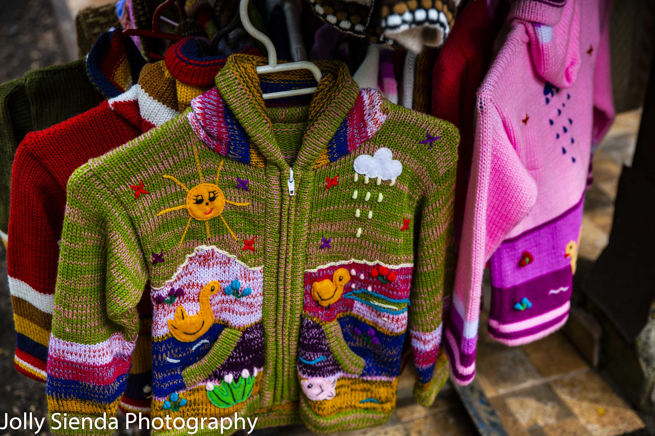 Colorful Chilean childrens woven sweaters