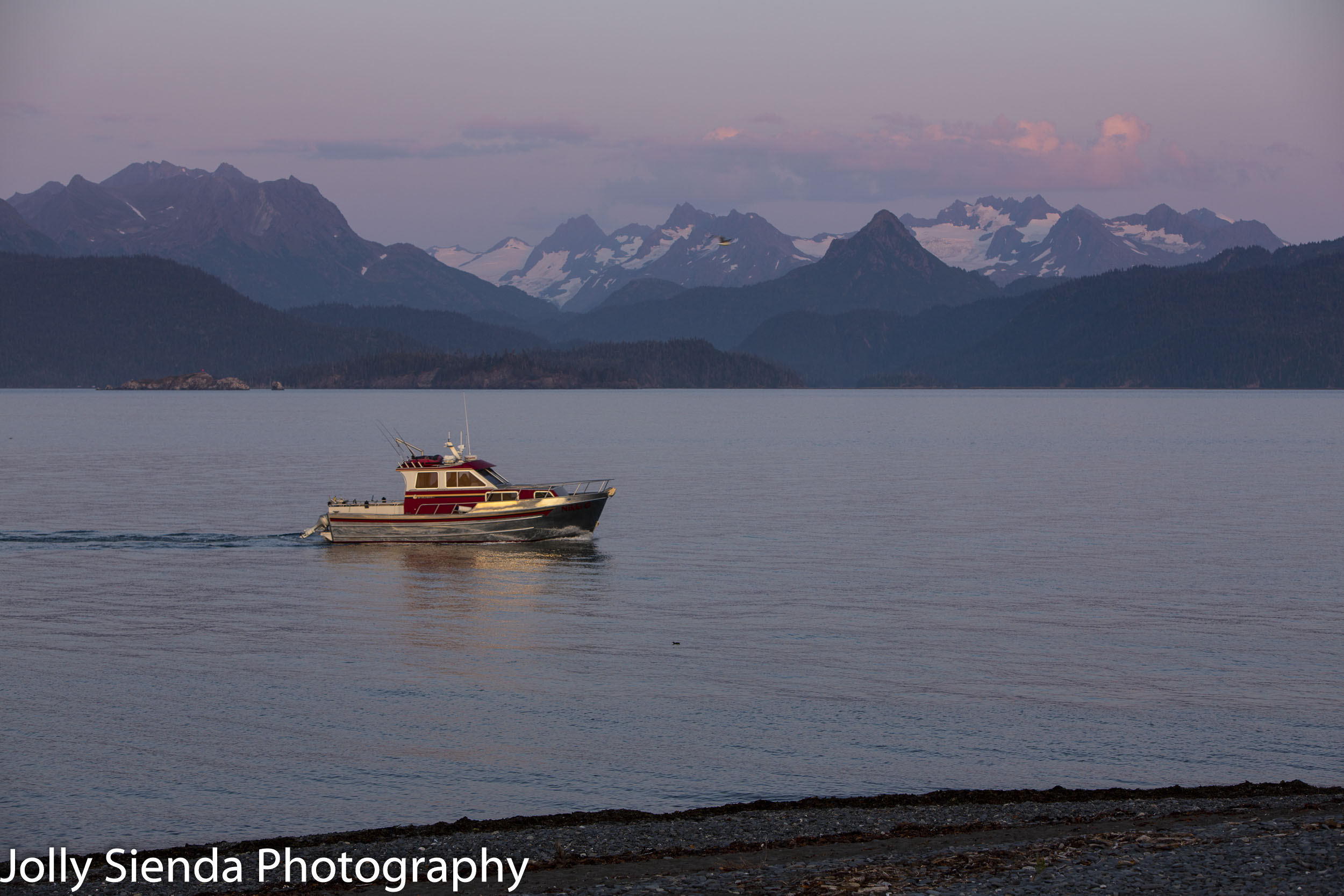 Boating on the  Kachemak Bay near glaciers and mountains