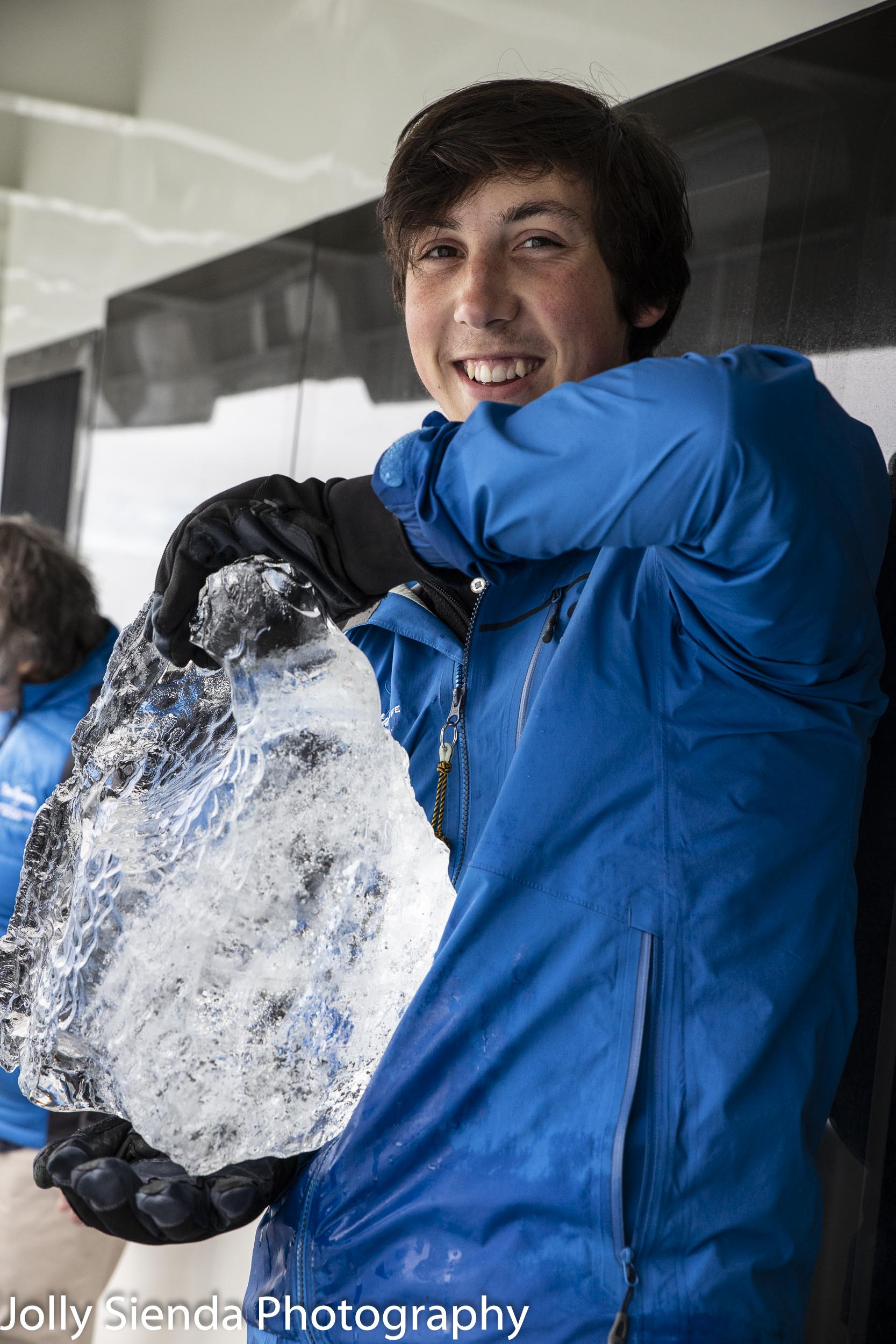 Person holding a bock of artic ice
