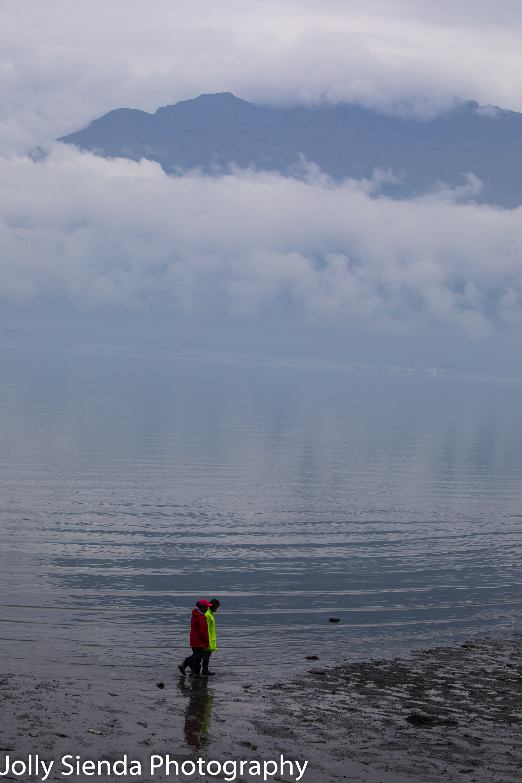 People walking in the Prince William Sound at low tide