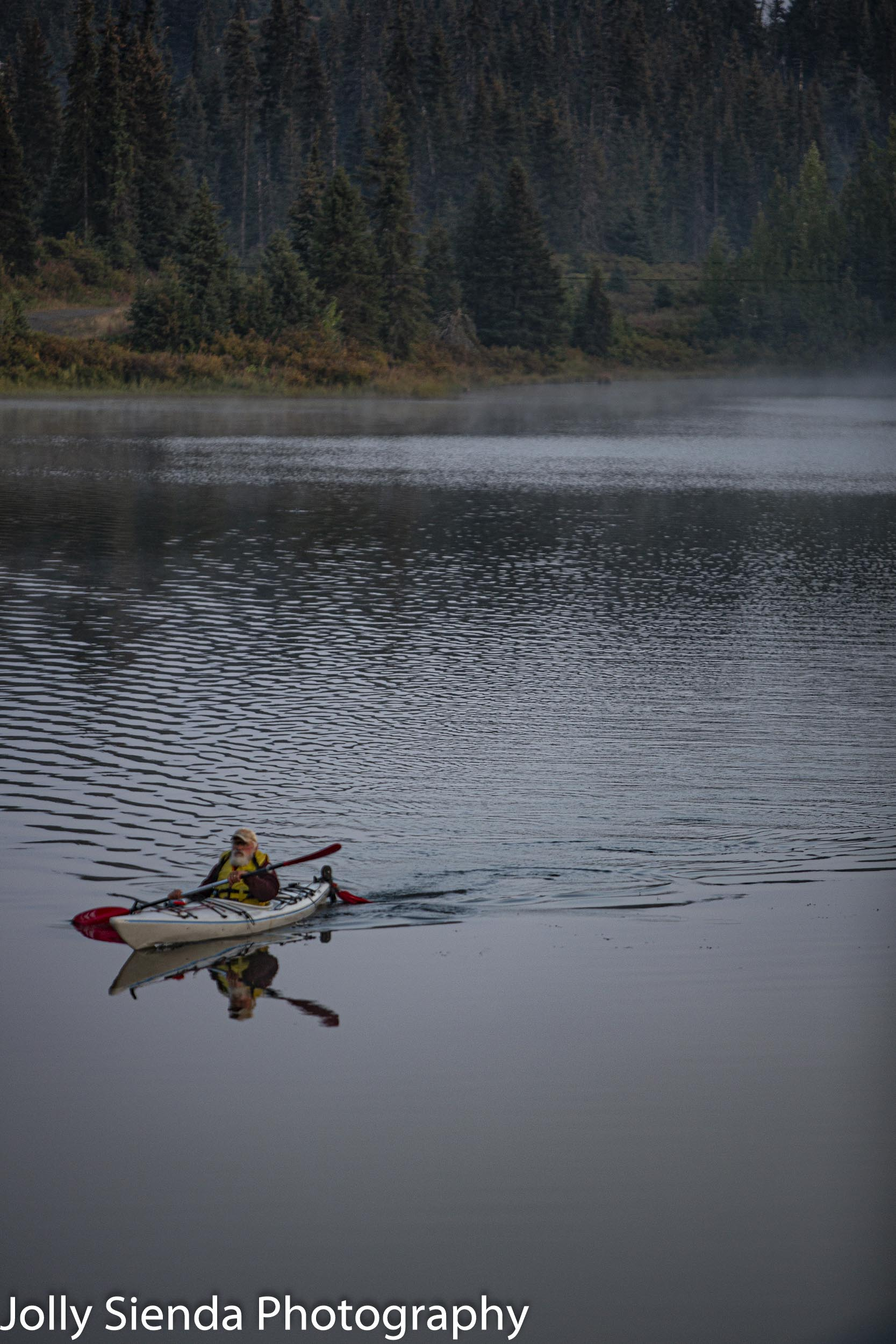 Kayaker on a lake in the Alaskan wilderness