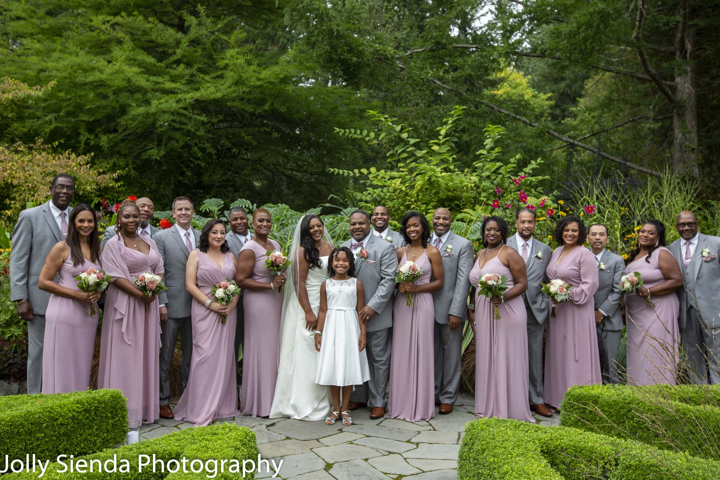Nioka and Jefferson Butler with their wedding party at Heronswood Garden, by Jolly Sienda Photography