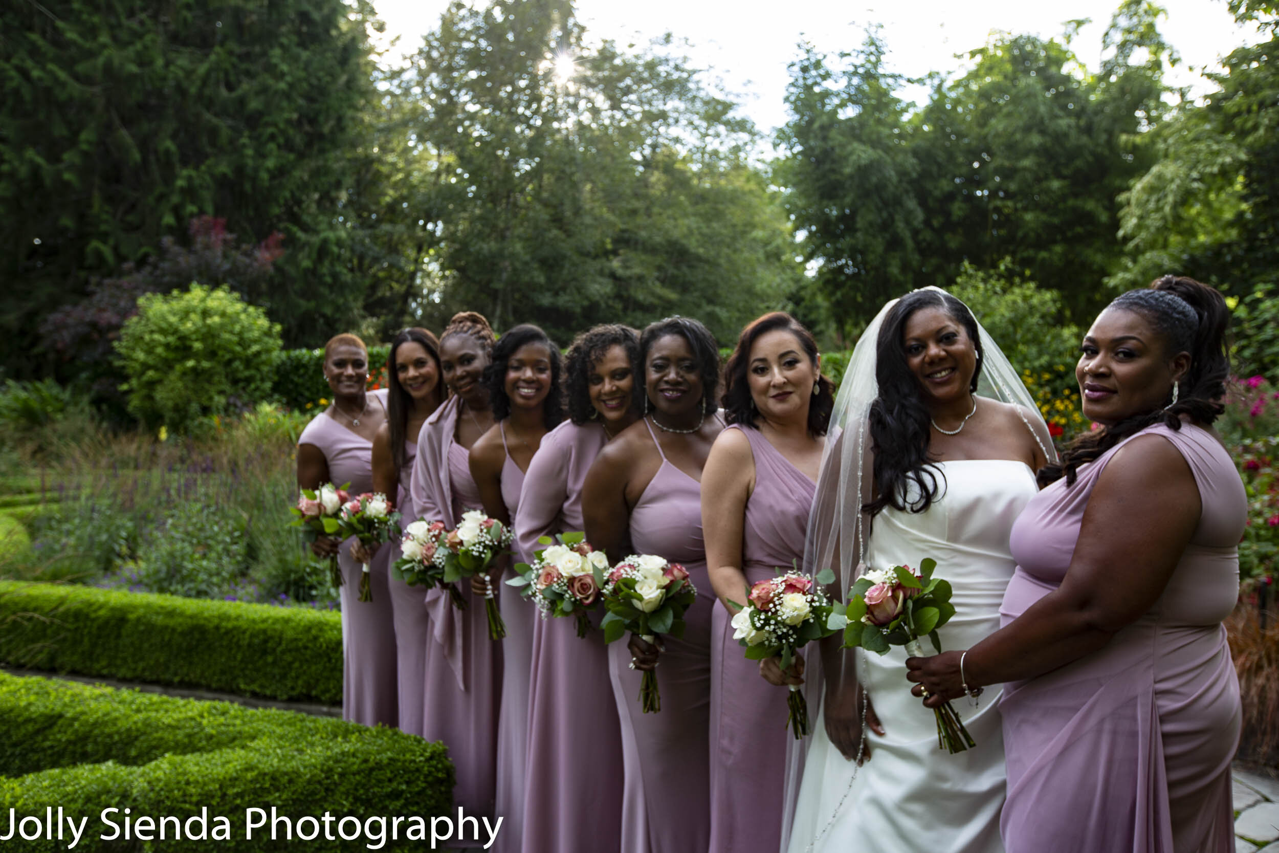 Nioka Butler with her bridesmaids at Heronswood Gardens by Jolly Sienda Photography