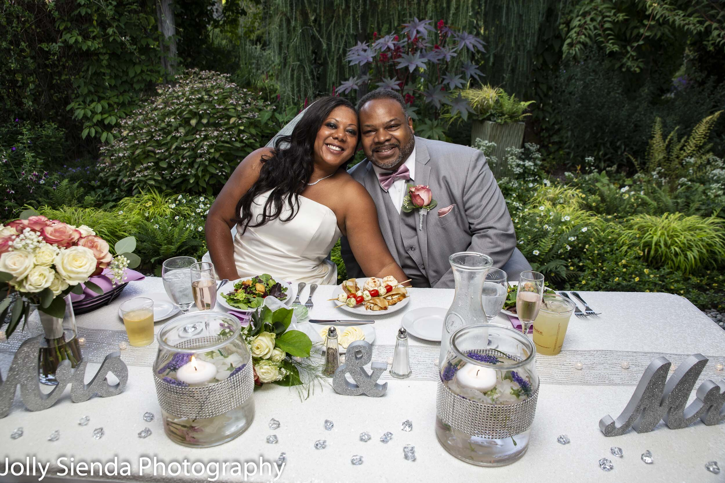 Mr. and Mrs. Jefferson Butler at their wedding reception, Heronswood Garden by Jolly Sienda Photography