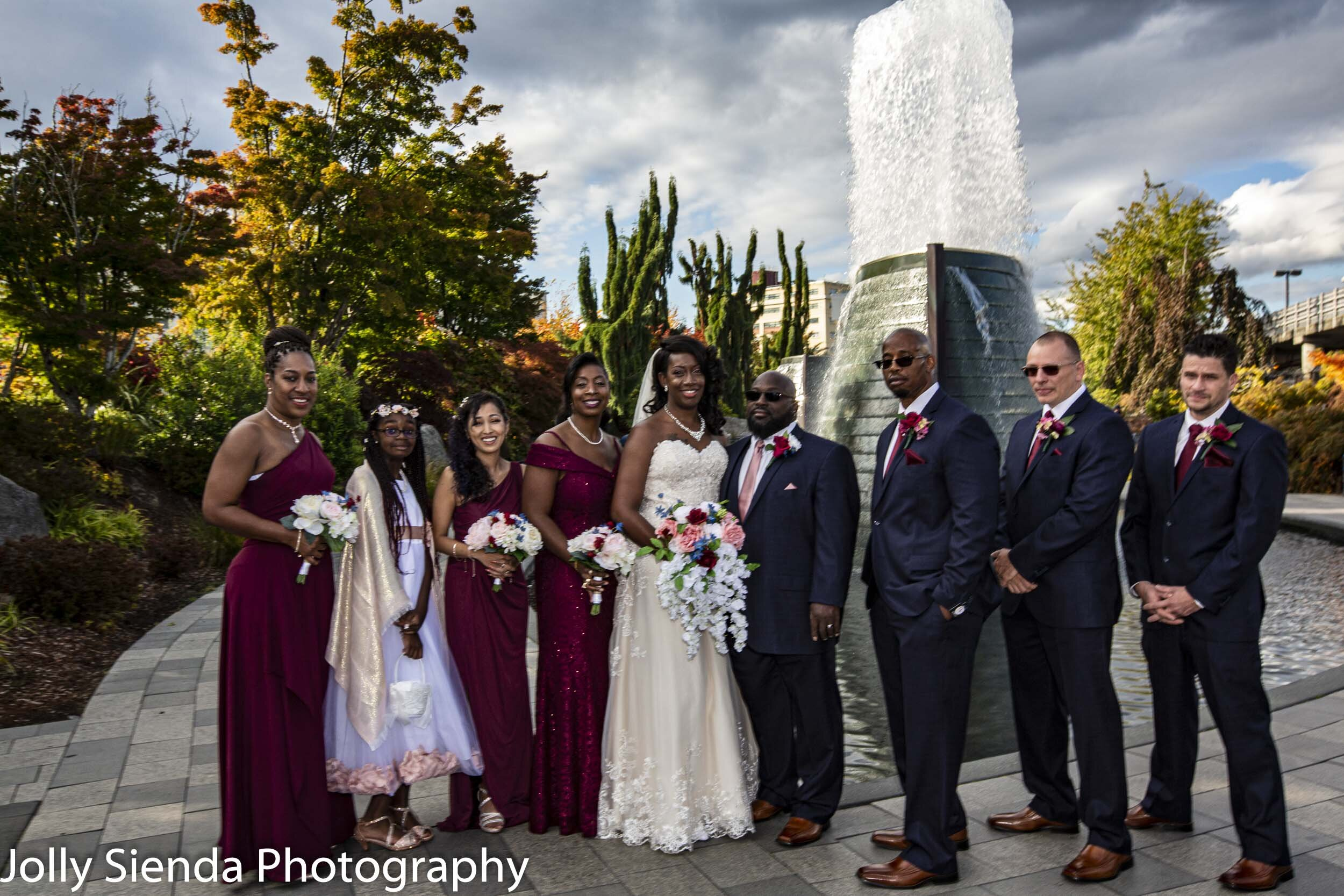 The bride and groom with their wedding party at Harborside Fountain Park, Bremerton, WA.