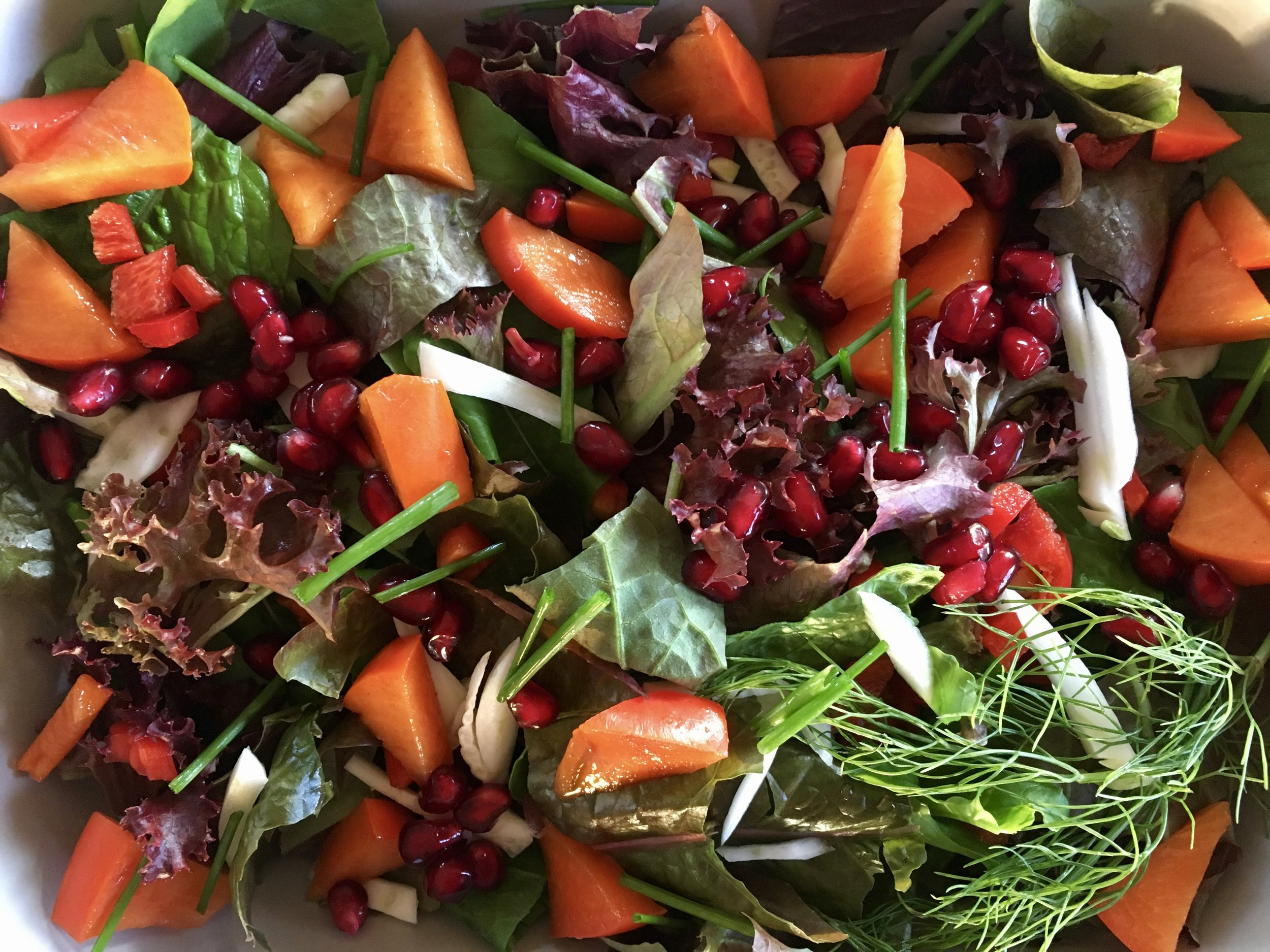 A winter garden salad with fall fruits.