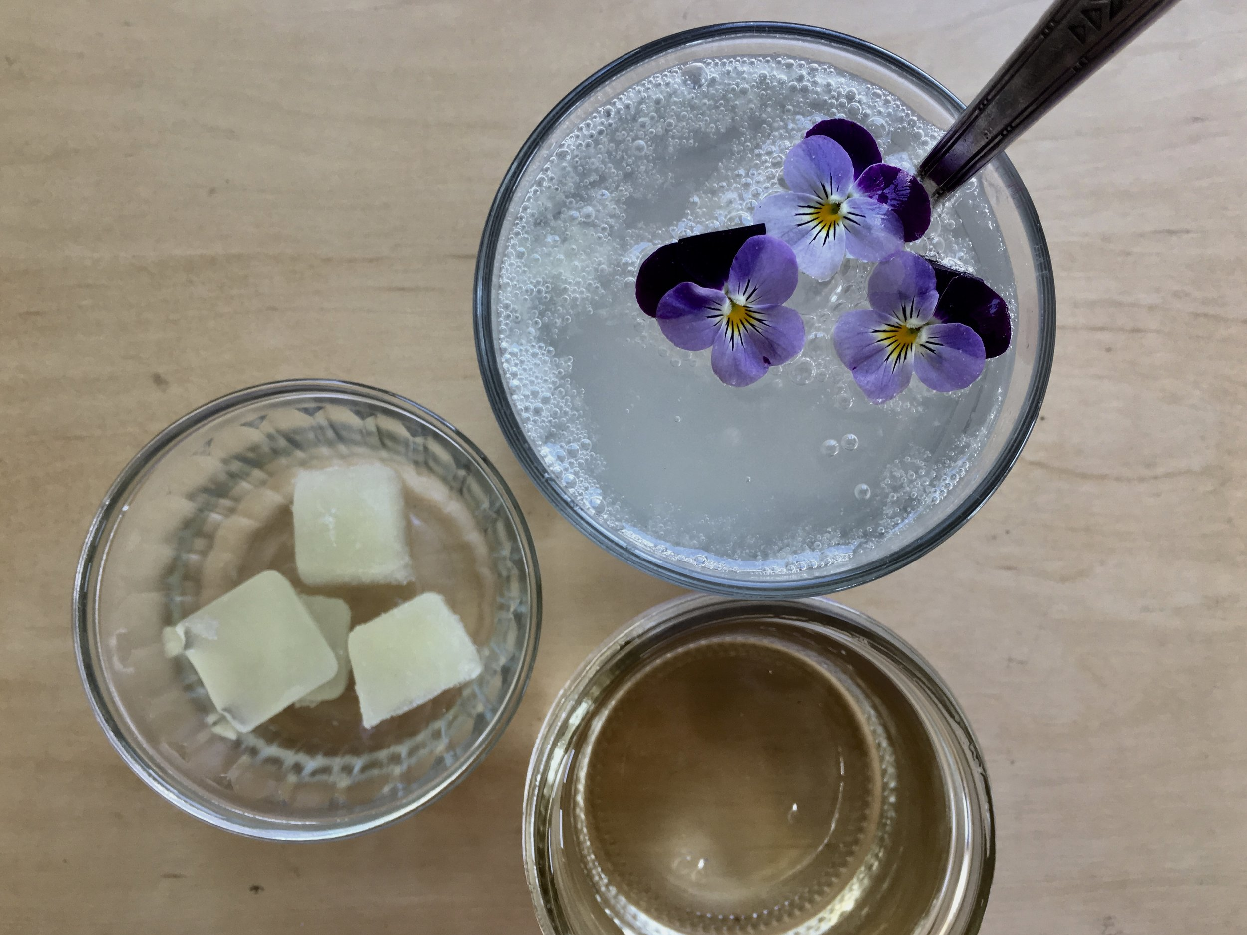 Lime soda with my frozen lime juice and violas.