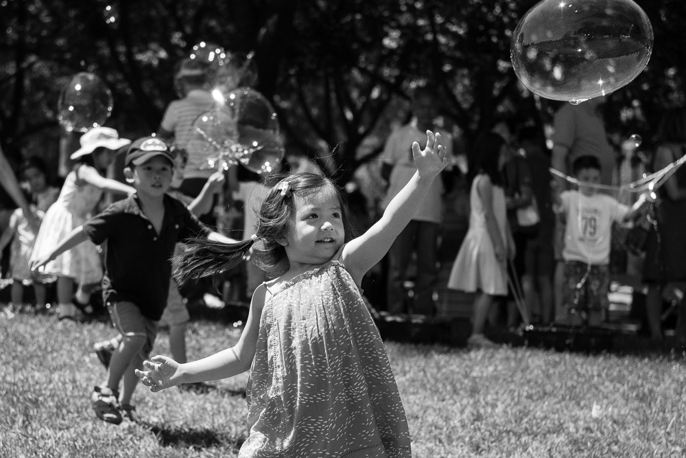 Girl chasing bubbles - Sunnyvale Children's Birthday Party Photography