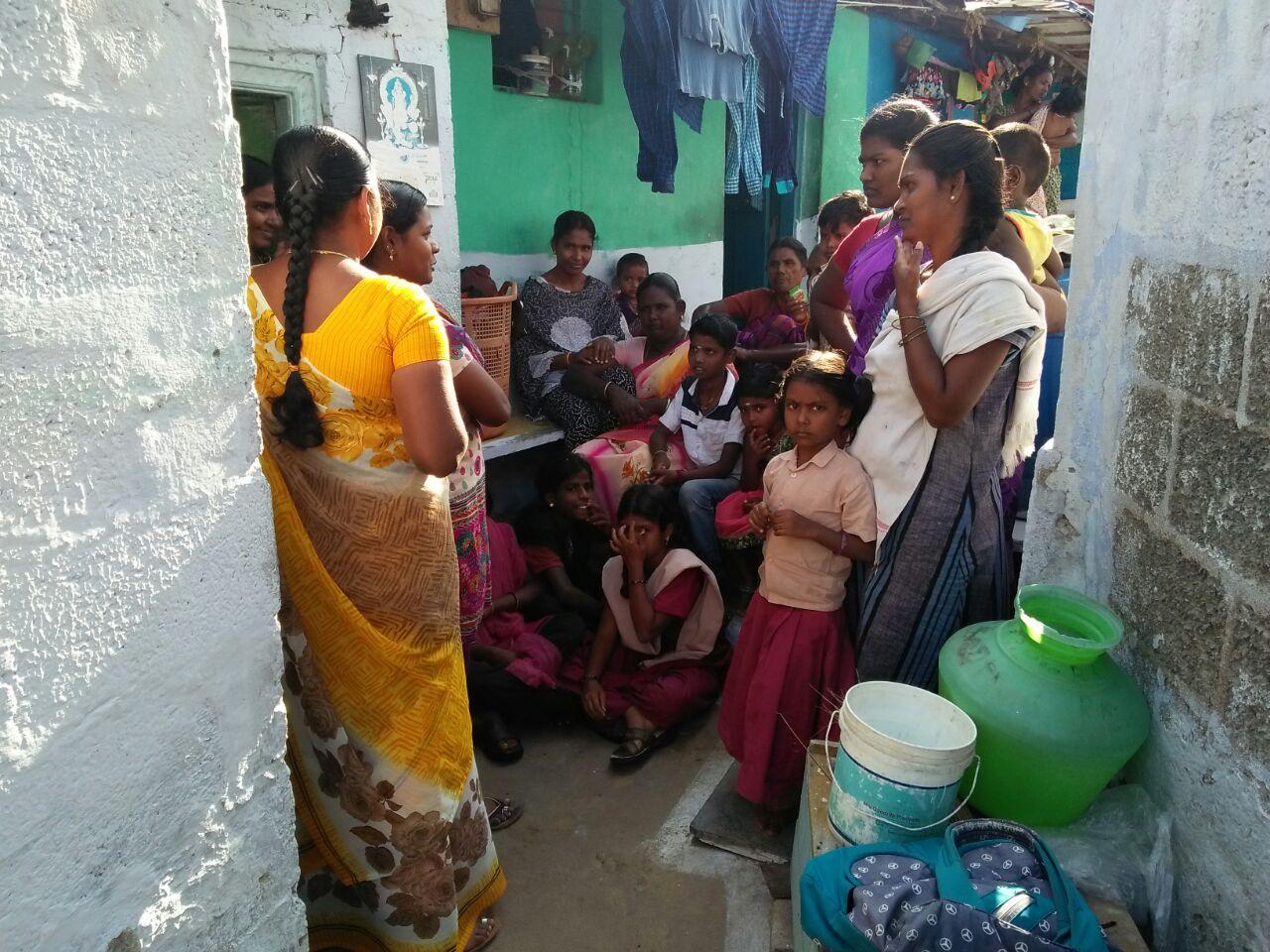 Family visit by staff at Arivuthirukoil area.jpg