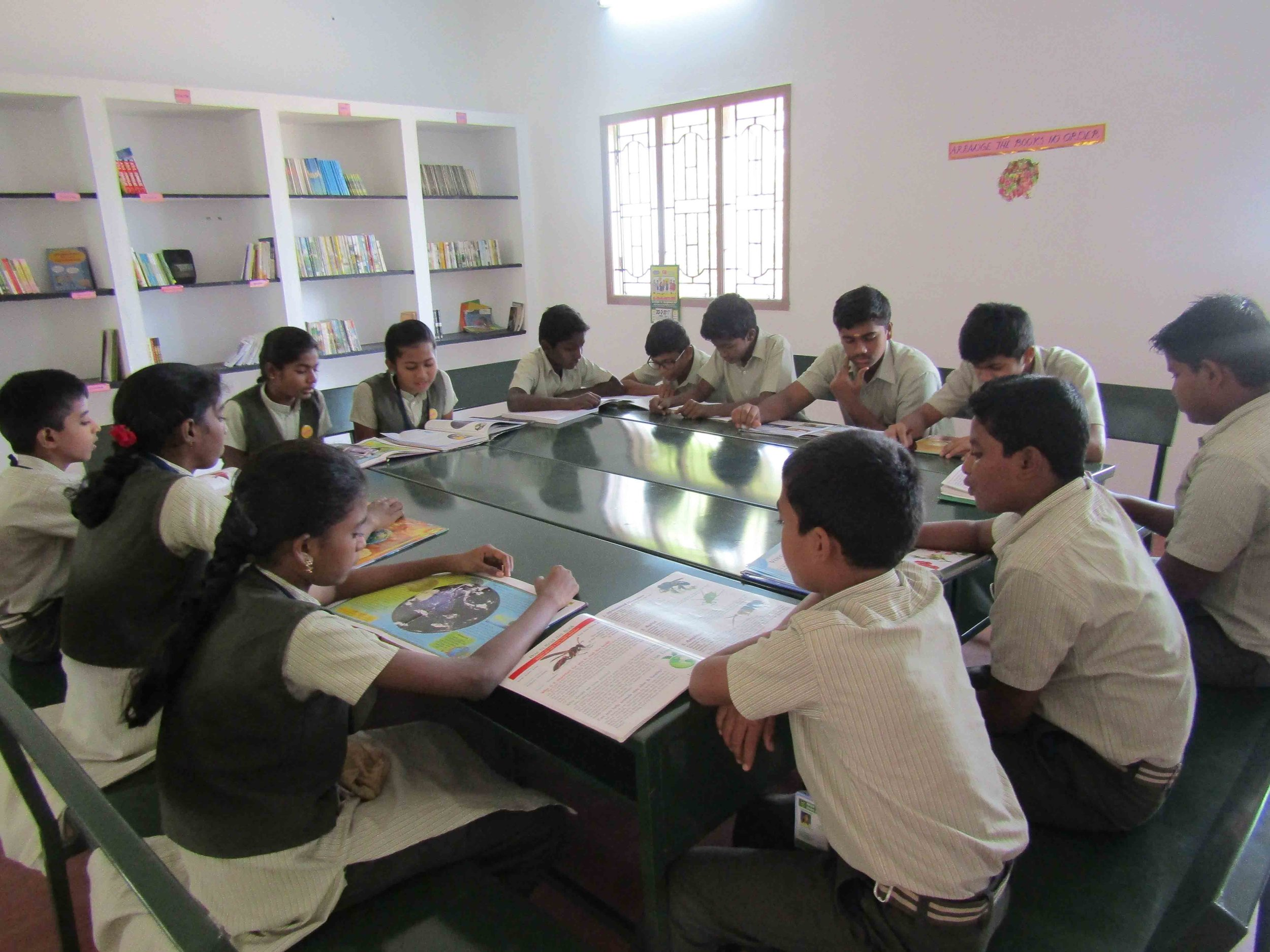 GPSS children at the school Library.jpg
