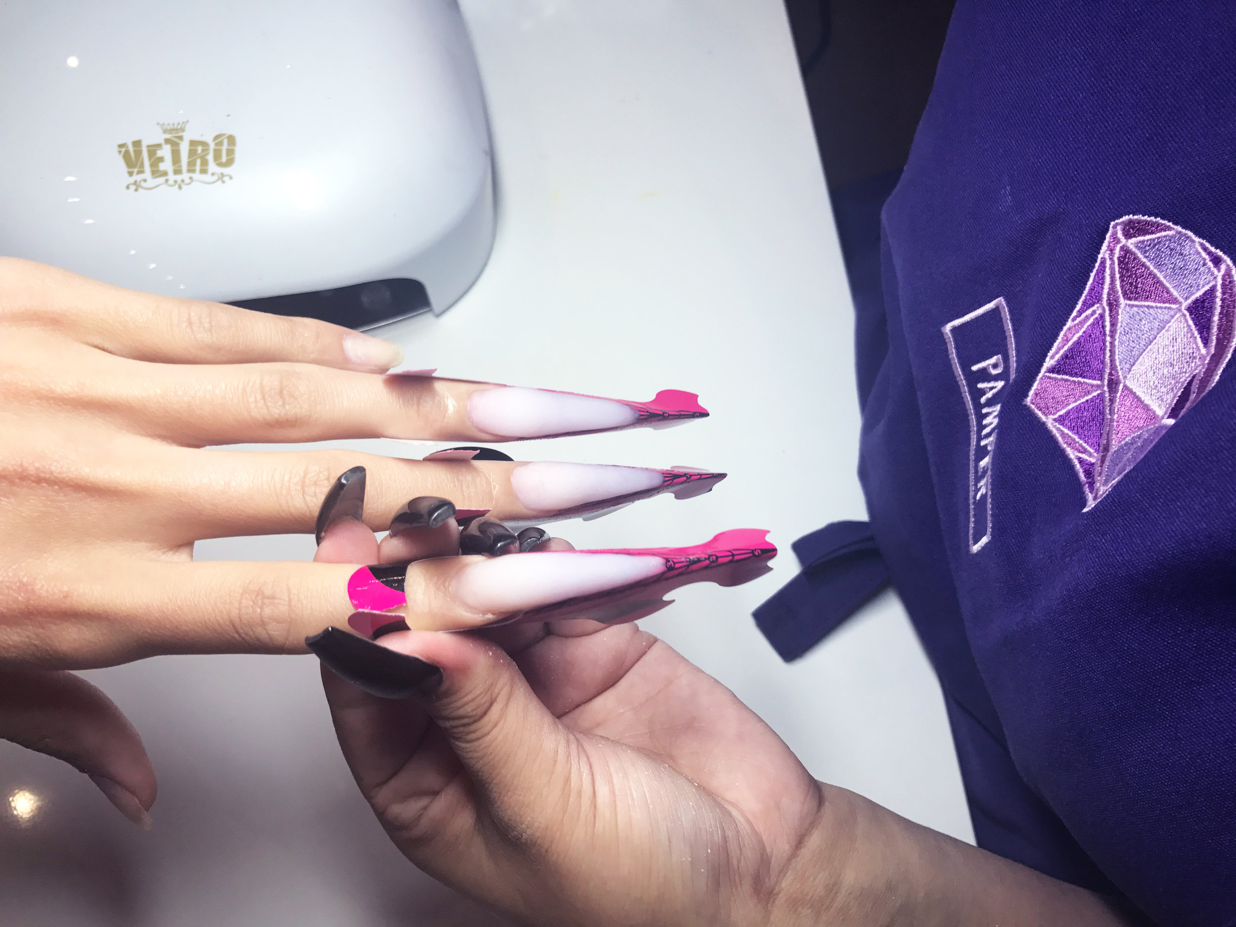 Pamper Artist Jackie (@nailsby_jackiee) sculpting long skinny stilettos with Young Nails brand acrylic in Frosted Pink.