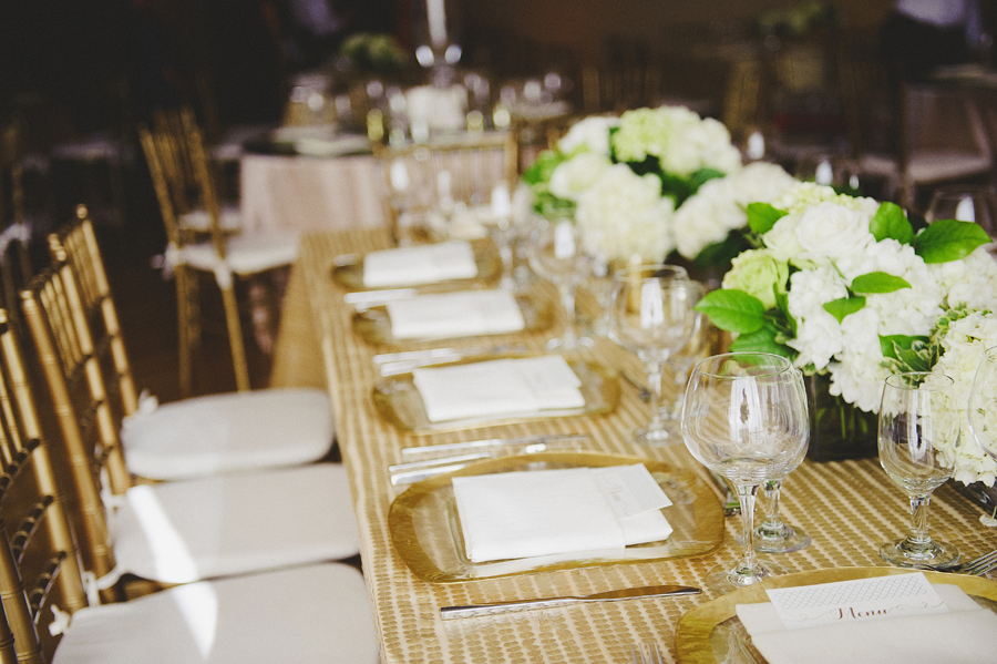 Table setting for white and green wedding ceremony by Yellow Canary Floral & Event Design