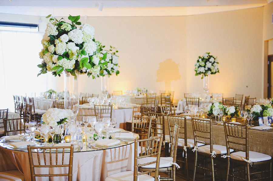 White and green focal arrangements for wedding ceremony by Yellow Canary Floral & Event Design