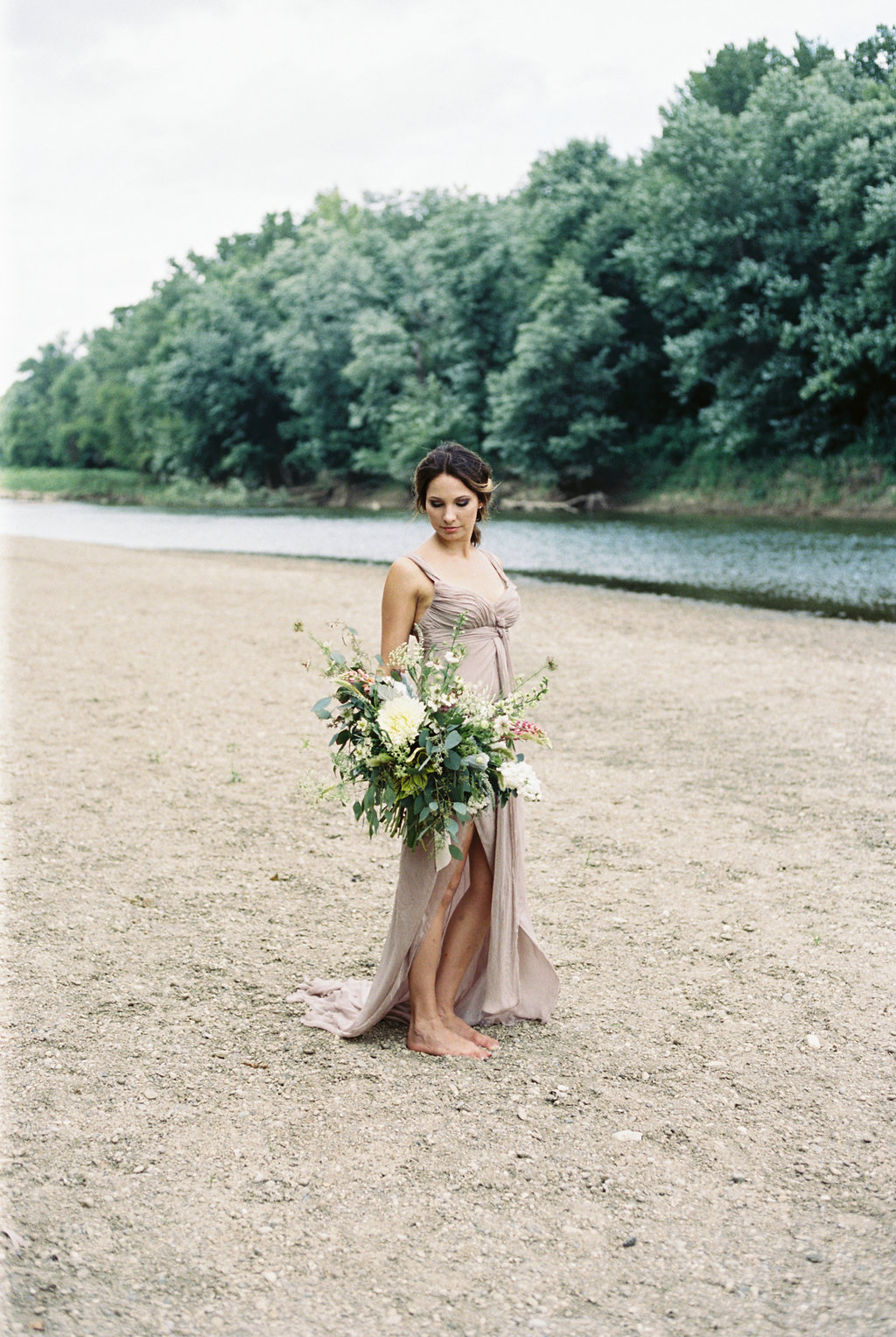 River's edge elopement with floral by Yellow Canary Floral & Event Design. Photos by Caroline Koehler Photography
