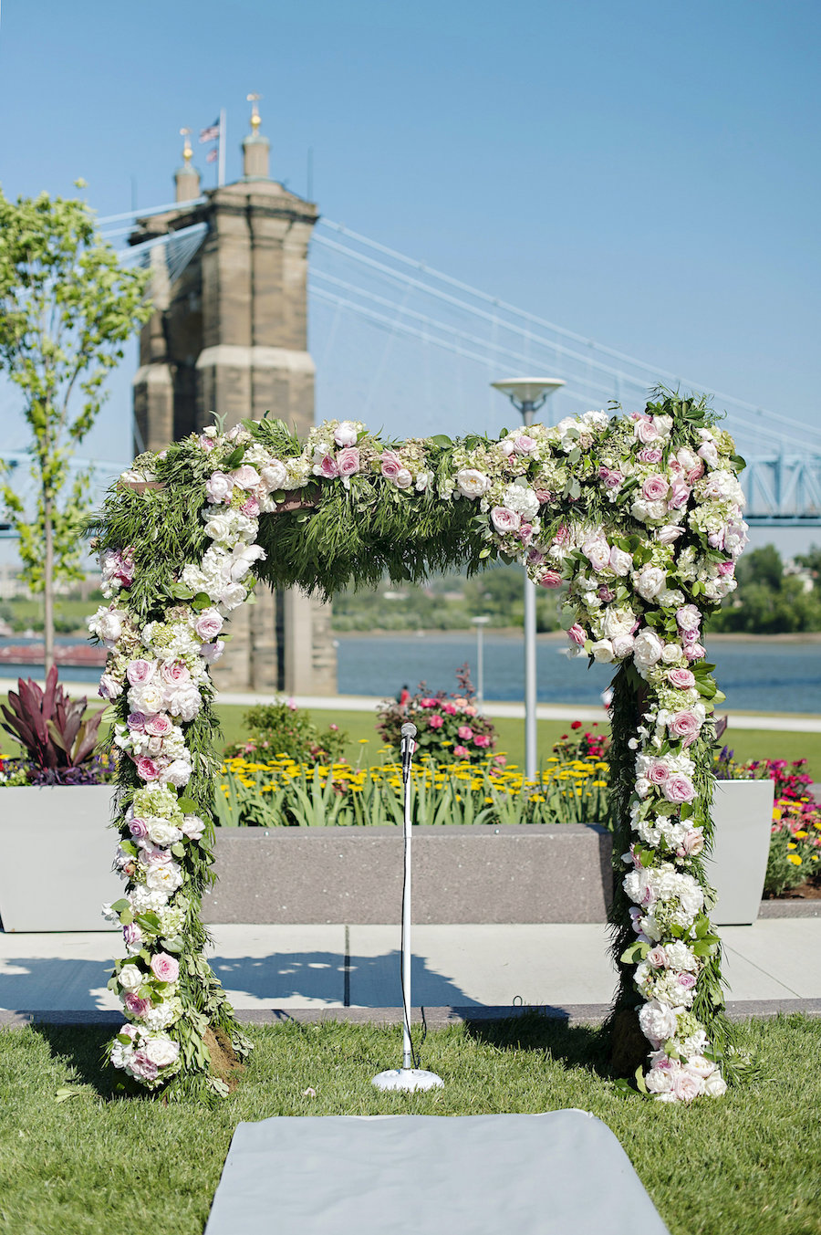 Floral wedding ceremony arch by Yellow Canary floral and event design.