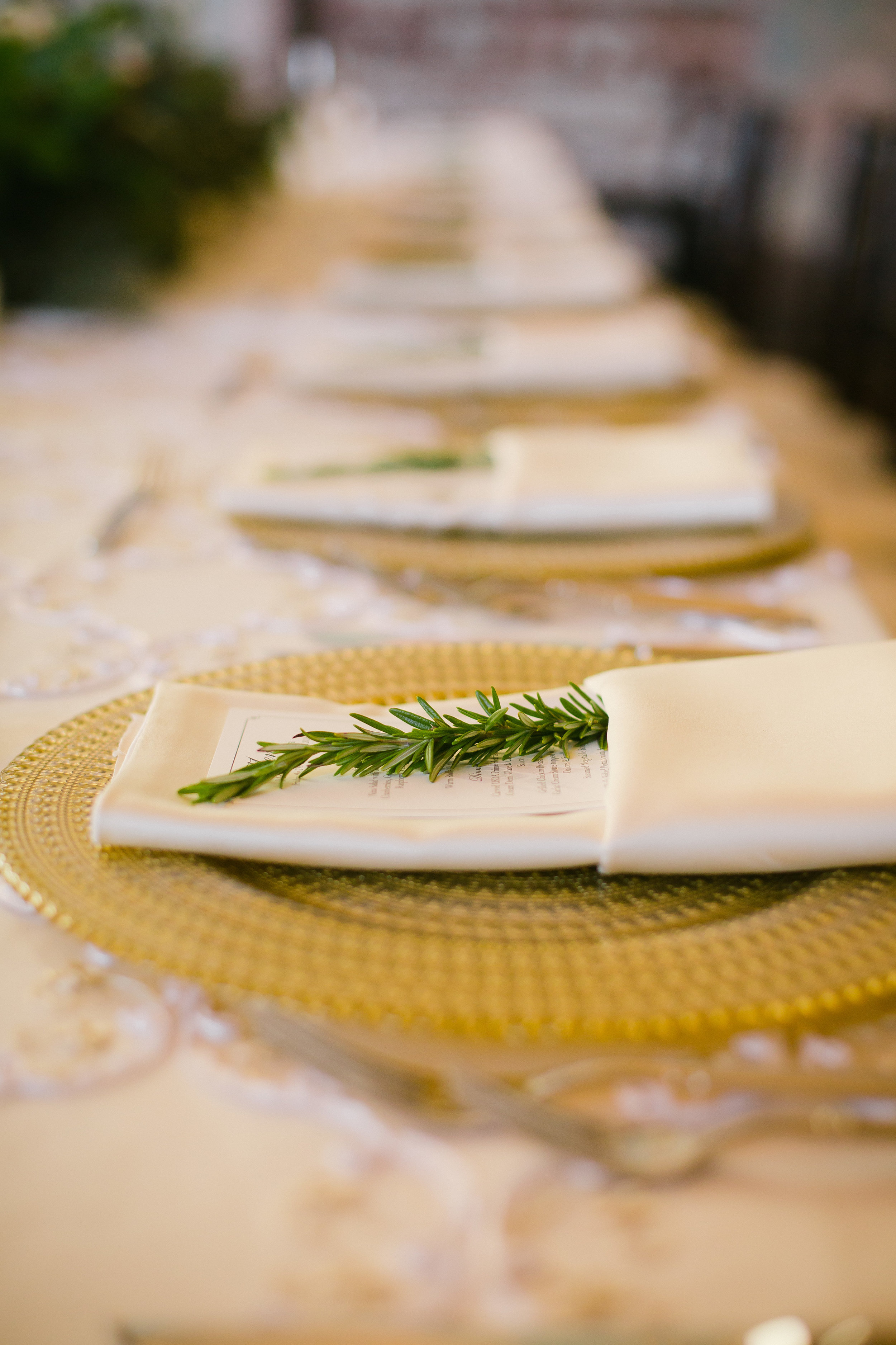 Place settings with herb for Monastery Event Center wedding in Cincinnati.  Florals by Yellow Canary www.yellowcanaryonline.com