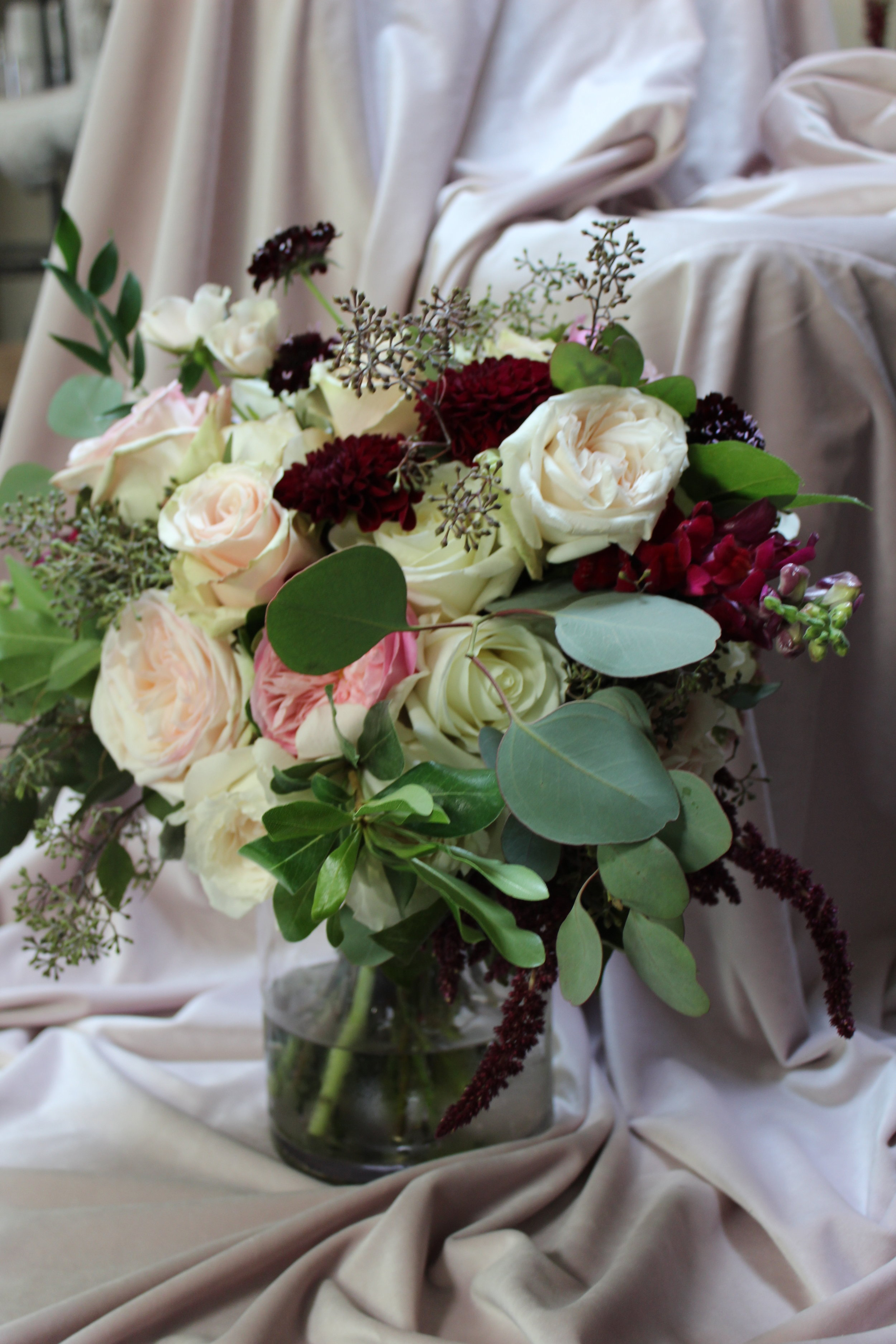 We spent the afternoon working with a unique color and texture palette for a wedding reception at The Renaissance Hotel in Cincinnati. Among the eucalyptus and sedum were milky mauve and cream roses, dazzling white hydrangeas, and snapdragons whose blooms were the deep wine of cherry skin. www.yellowcanaryonline.com
